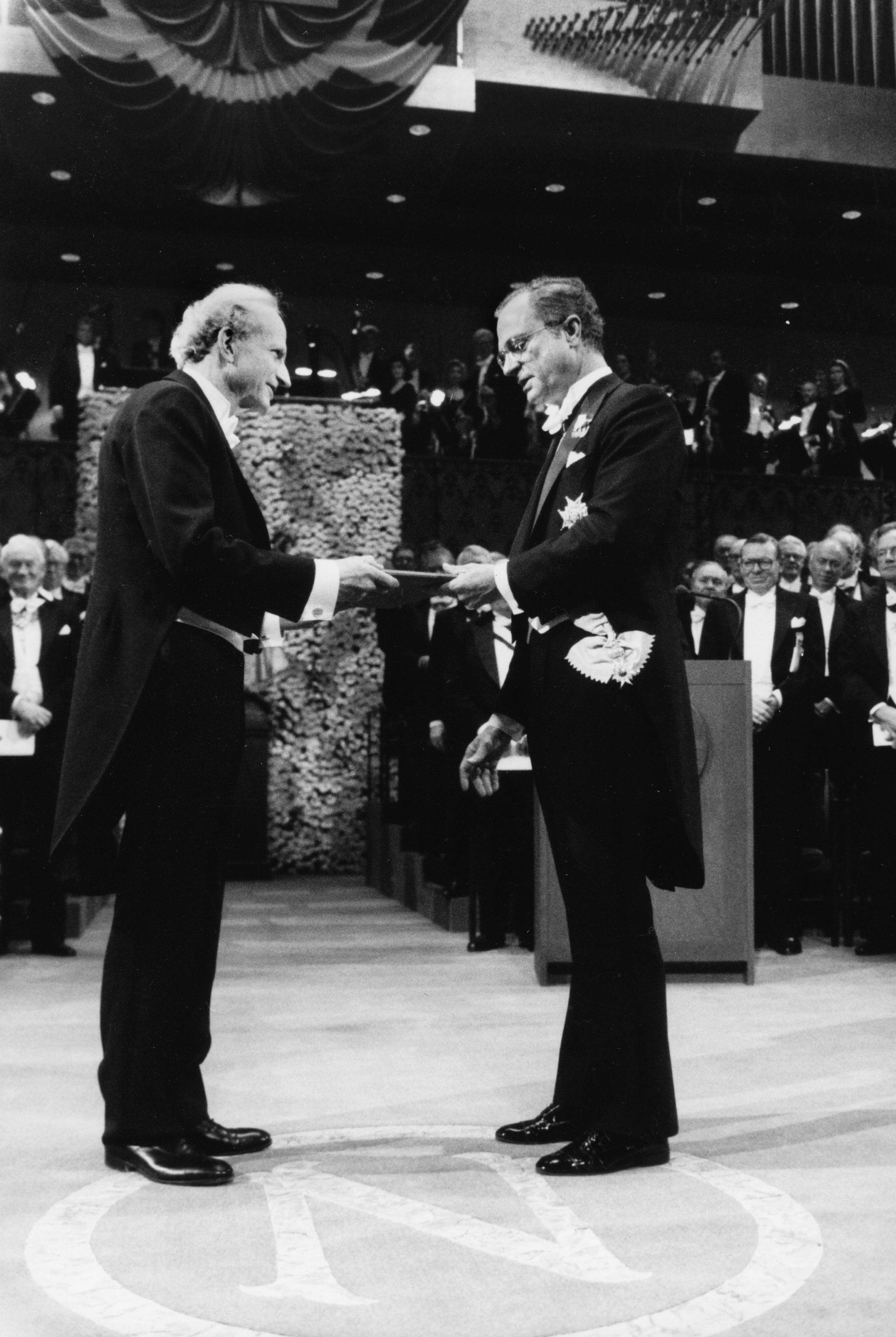 Gary S. Becker, left, from the University of Chicago, receives the 1992 Nobel Economics Prize from the hands of Sweden's King Carl XVI Gustaf, during the Nobel awarding ceremony in the Concert Hall in Stockholm, Sweden.