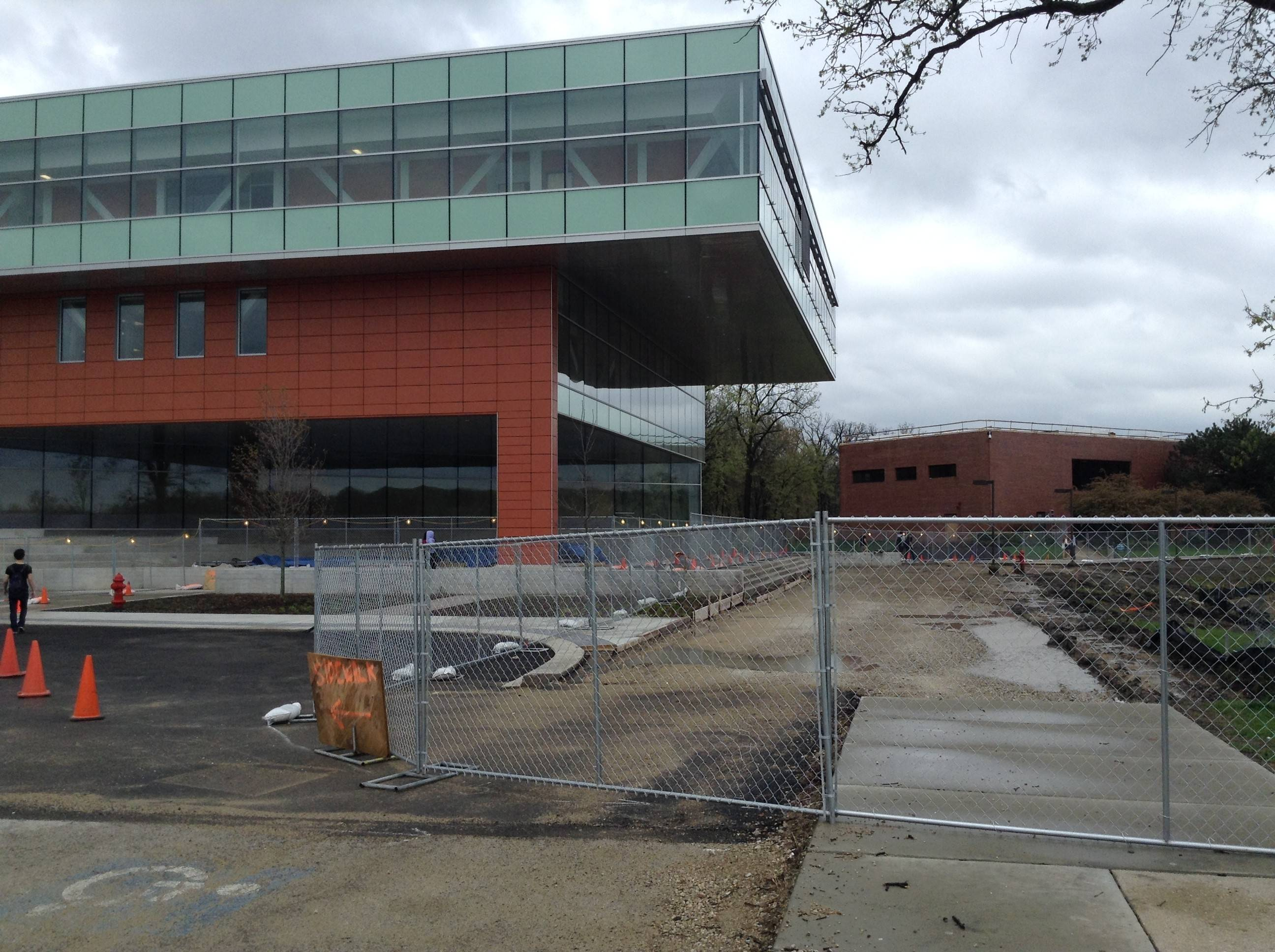 Problems with a concrete slab on the west side of Oakton Community College's new $39 million Science and Health Career Center has delayed the opening of the building until January 2015.