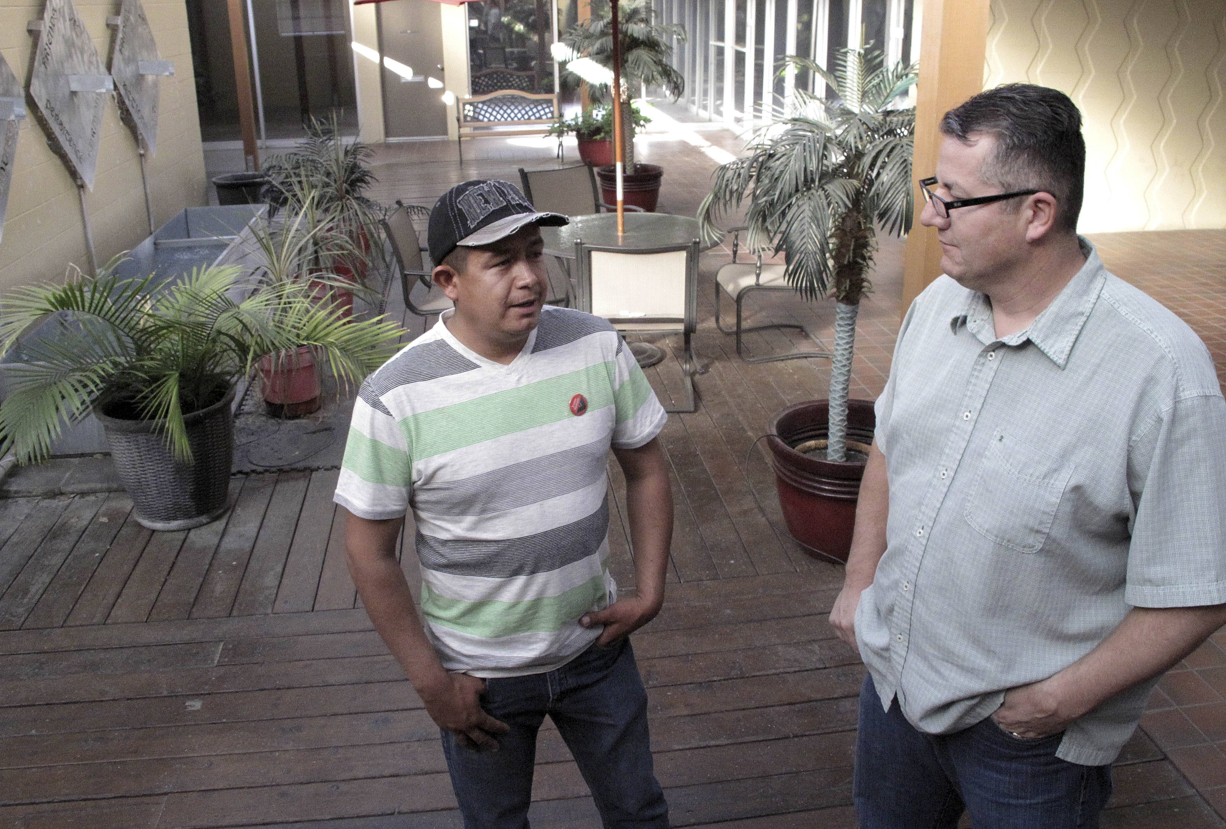 Farmworker Severiano Salas, left, speaks with United Farm Workers National Vice President Armando Elenes in Fresno, Calif.