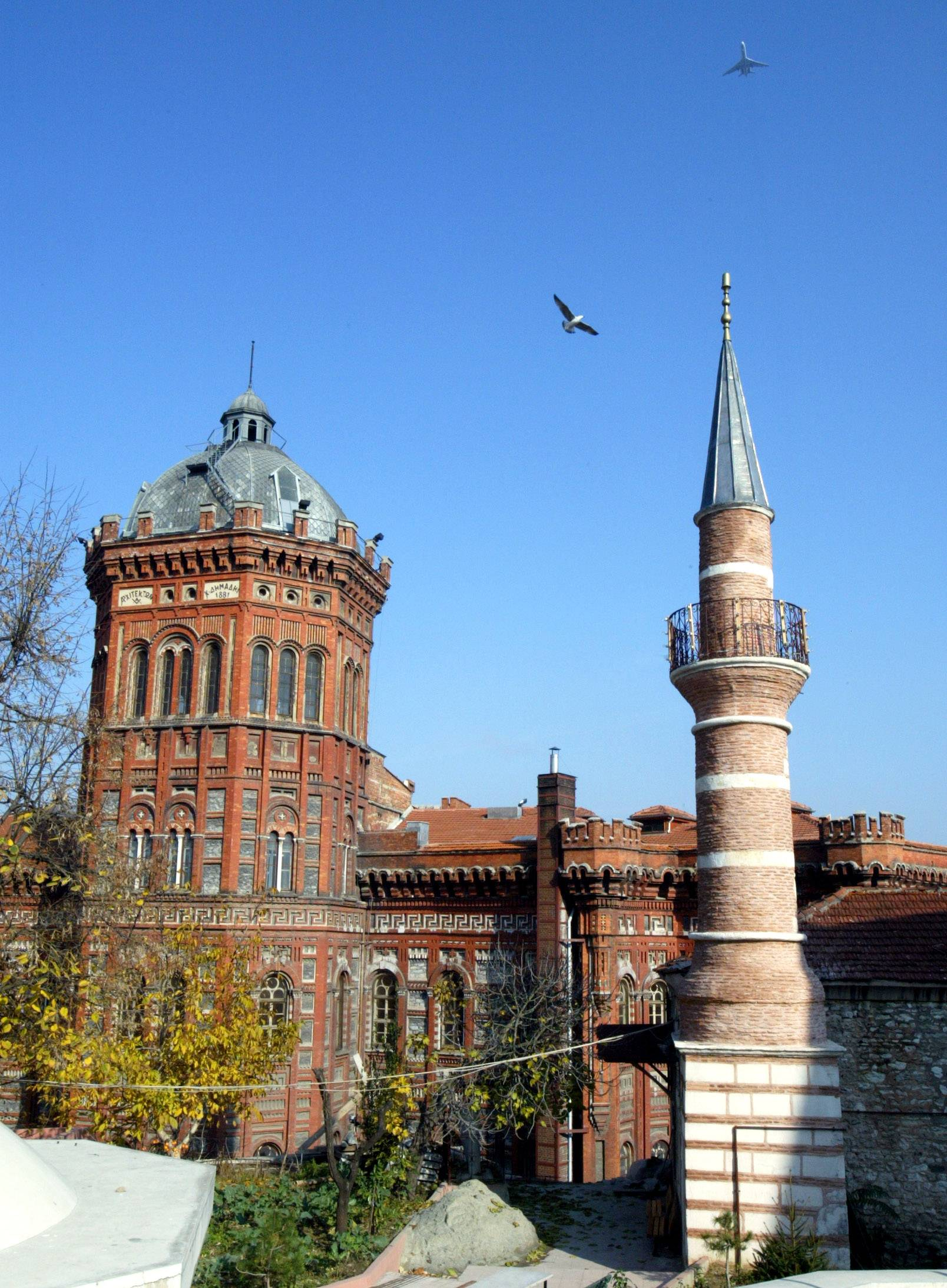 The Historical Greek Orthodox high school, left, stands next to a mosque in Istanbul's Fener neighborhood.