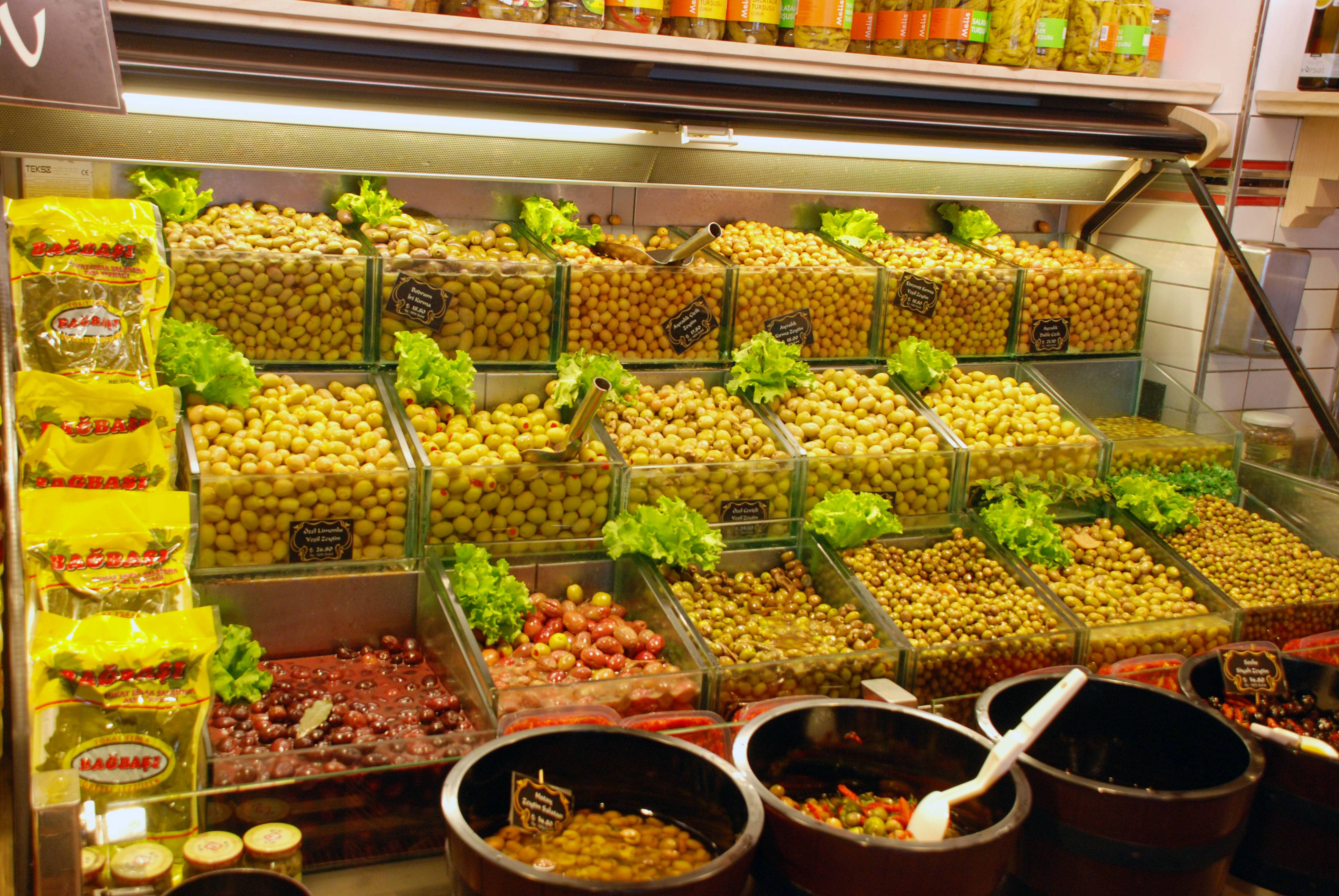 Visitors can choose from an array of olives in a shop in the neighborhood of Karakoy in Istanbul, Turkey.