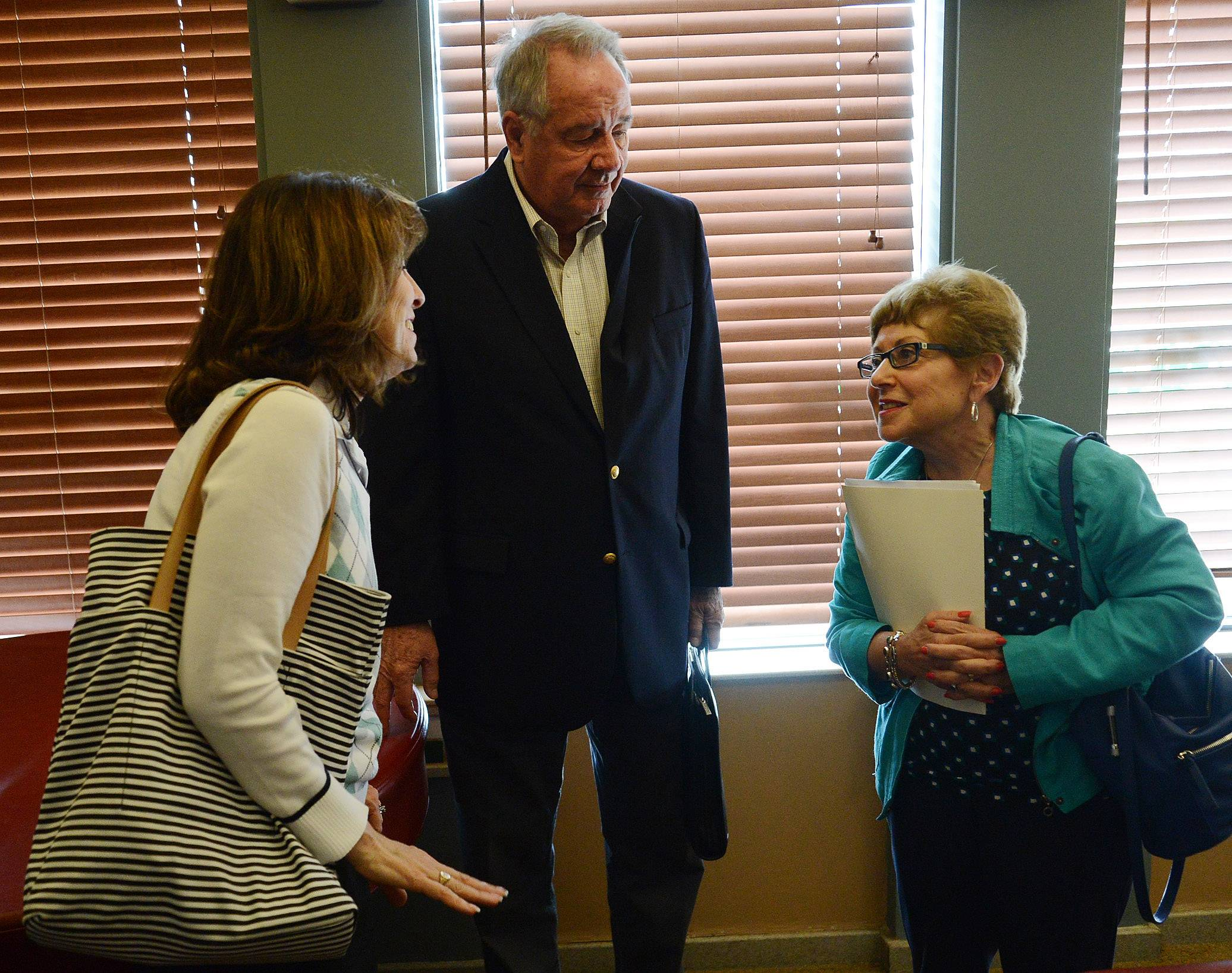 From left, Kathy Villano of Elk Grove Village, Burt Jensen of Inverness, and Sheila Schwartz of Hoffman Estates chat Monday before the On The Table event in Schaumburg.