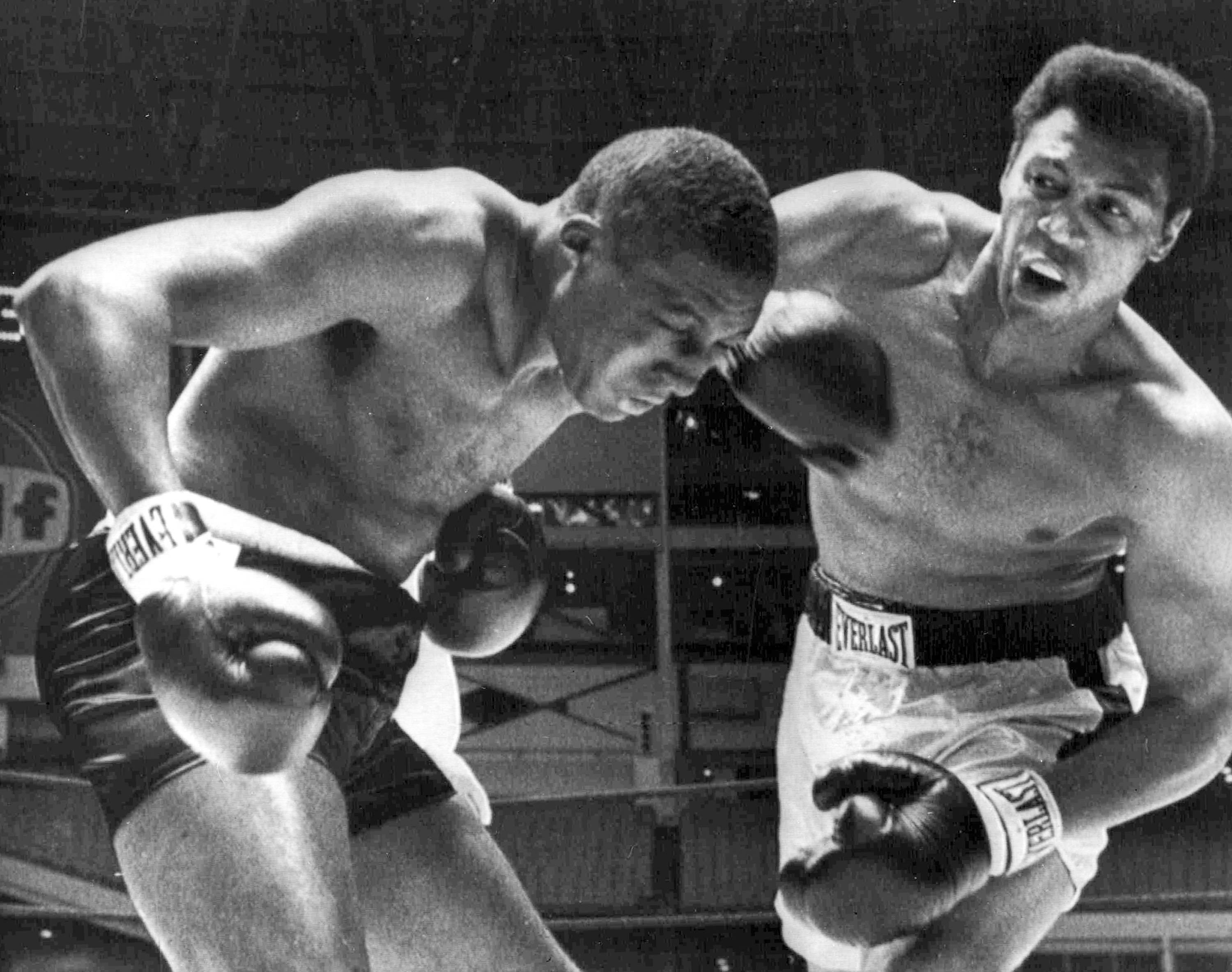 Jimmy Ellis, right, lands a right hook to the head  Leotis Martin during their 12-round World Heavyweight title elimination fight in Houston, Texas.