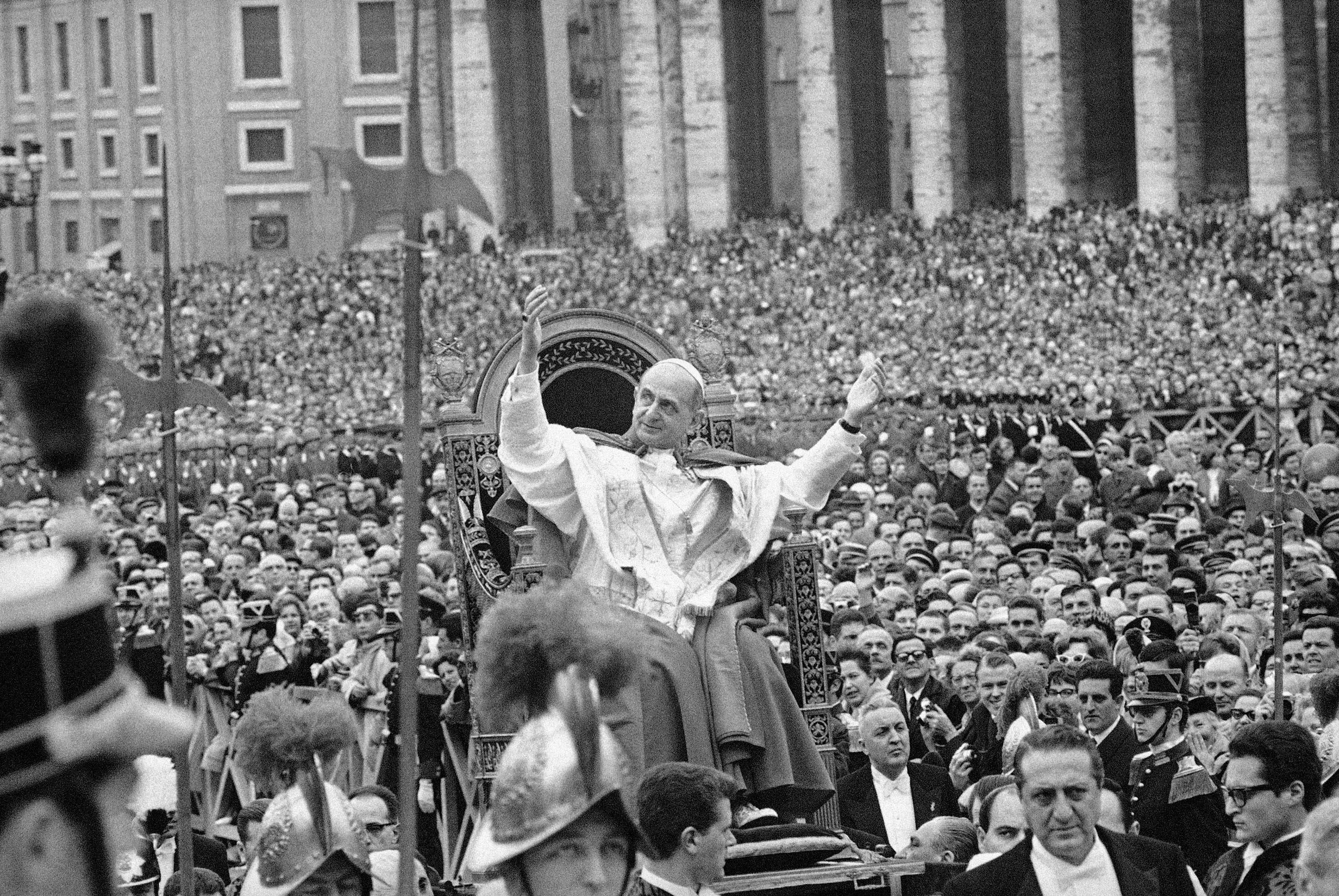 "In this file photo taken on March 29, 1964, Pope Paul VI salutes a crowd estimated at 200,000 as he is carried on portable throne through St. Peter's Square in Vatican City. Pope Francis has approved a miracle credited to the intercession of Paul VI and set the date for the late pontiff's beatification for Oct. 19, the Vatican said Saturday, May 10. Francis had authorized the beatification, the last formal step before possible sainthood, a day earlier, the Vatican said. Paul VI, who reigned as pontiff from 1963-1978, made landmark progress in improving Catholics' relationship with other Christians. His papacy is also remembered by his decision, after years of study, to ban contraception for Catholics, in a 1968 encyclical, ""Humanae Vitae"" (""of human life"")."