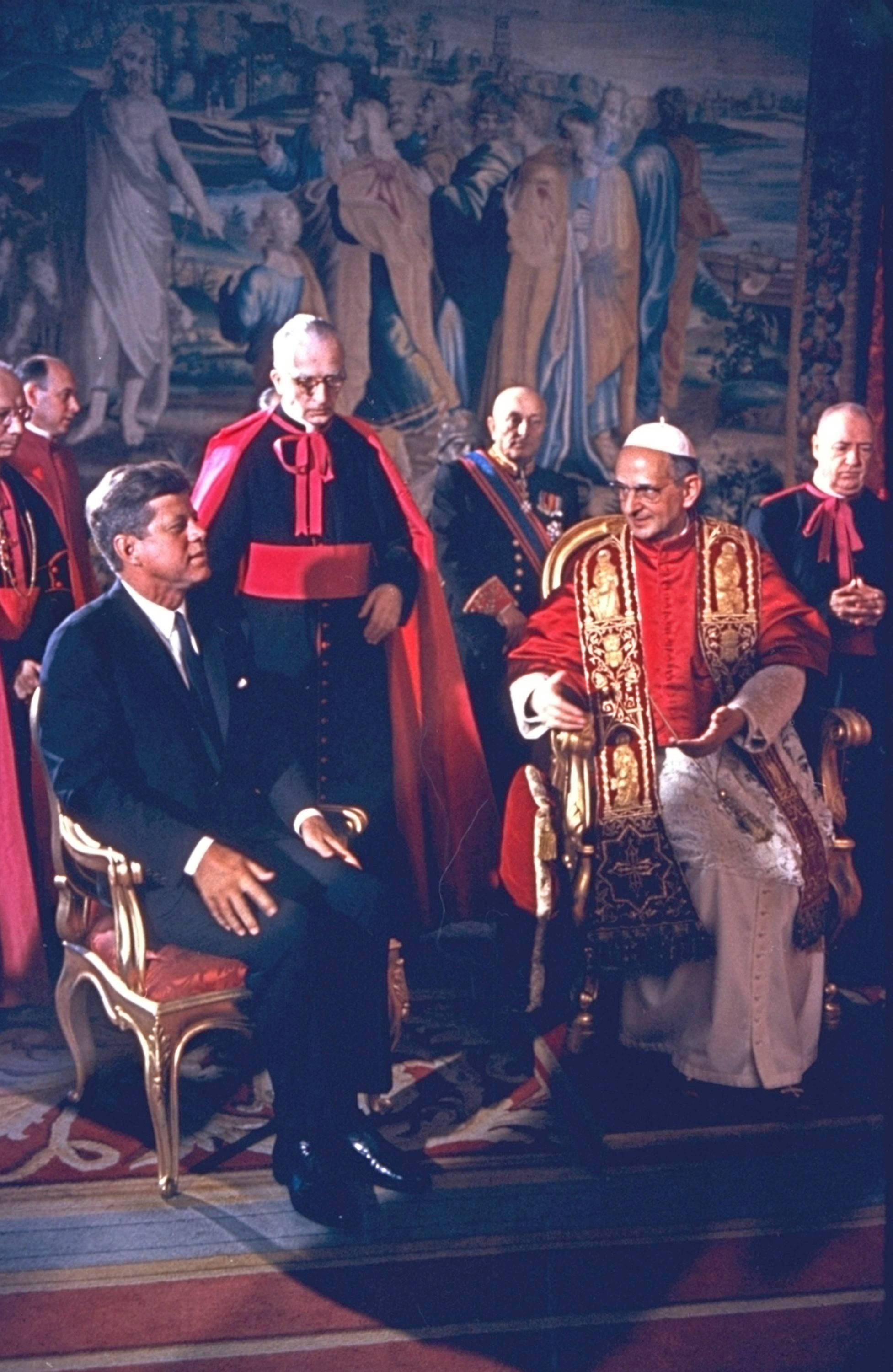 "In this file photo, taken on July 3, 1963, President Kennedy is shown at the Vatican in an audience with Pope Paul VI. Pope Francis has approved a miracle credited to the intercession of Paul VI and set the date for the late pontiff's beatification for Oct. 19, the Vatican said Saturday. Francis had authorized the beatification, the last formal step before possible sainthood, a day earlier, the Vatican said. Paul VI, who reigned as pontiff from 1963-1978, made landmark progress in improving Catholics' relationship with other Christians. His papacy is also remembered by his decision, after years of study, to ban contraception for Catholics, in a 1968 encyclical, ""Humanae Vitae"" (""of human life"")."
