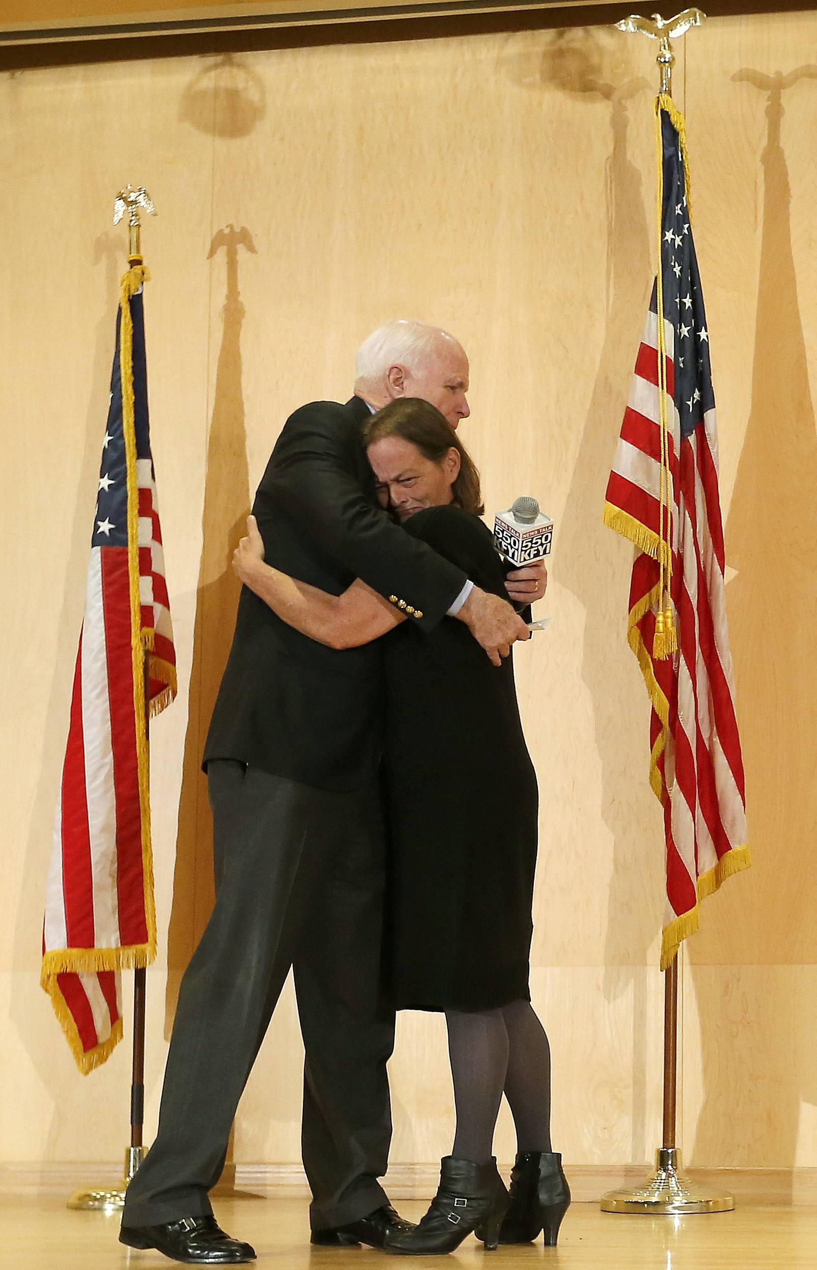 Sen. John McCain embraces Gabriel Basso after she shared how her veteran husband died during a forum with veterans on Friday, May 9, in Phoenix. McCain was discussing lapses in care at the Phoenix Veterans Affairs hospital that prompted a national review of operations around the country.