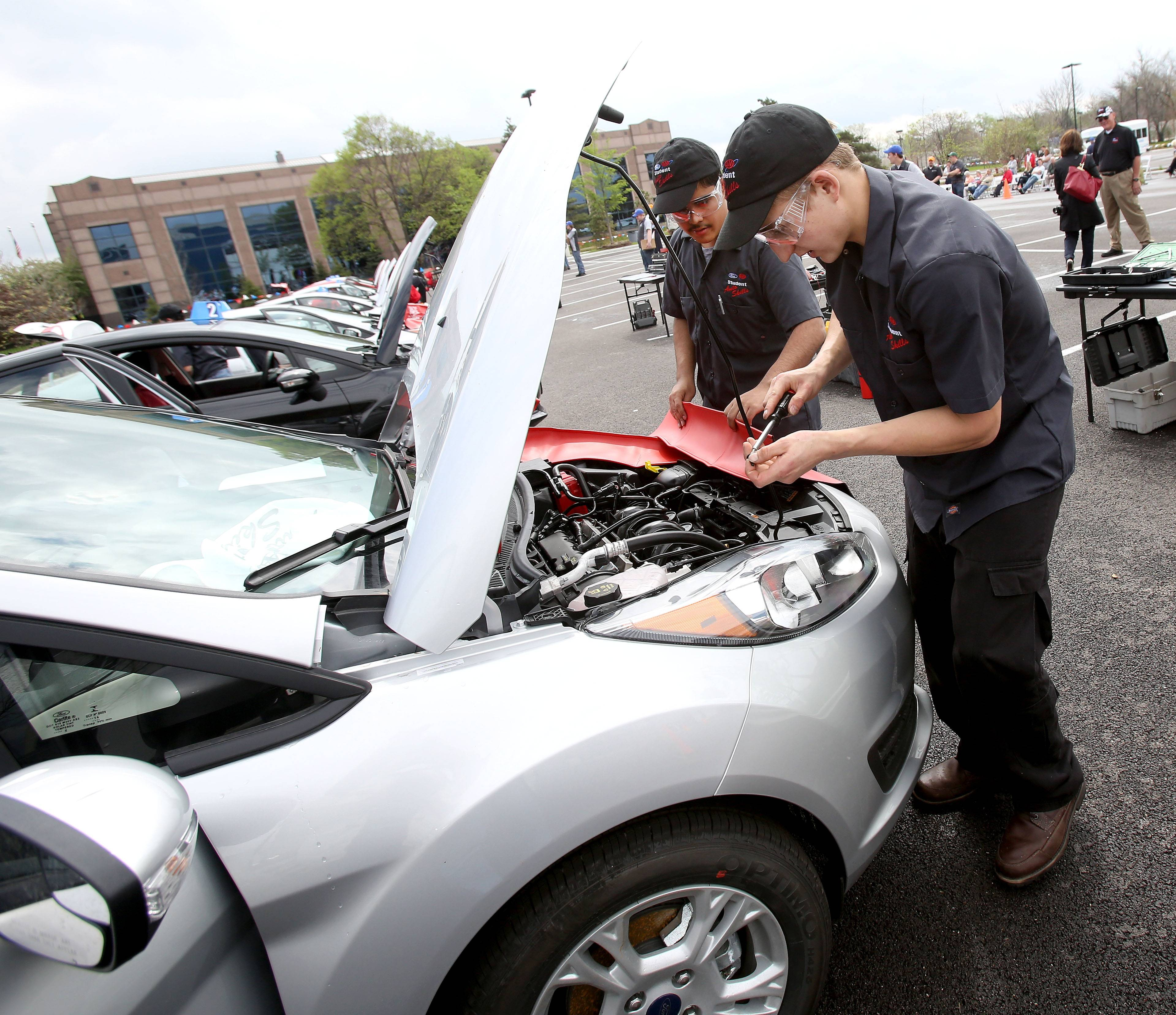 Bev Horne/bhorne@dailyherald.comChristian Ramirez, left, and Edward Pszczolkowski of Hoffman Esates High School won second place in Friday's Ford/AAA Student Auto Skills competition at Universal Technical Institute in Lisle.