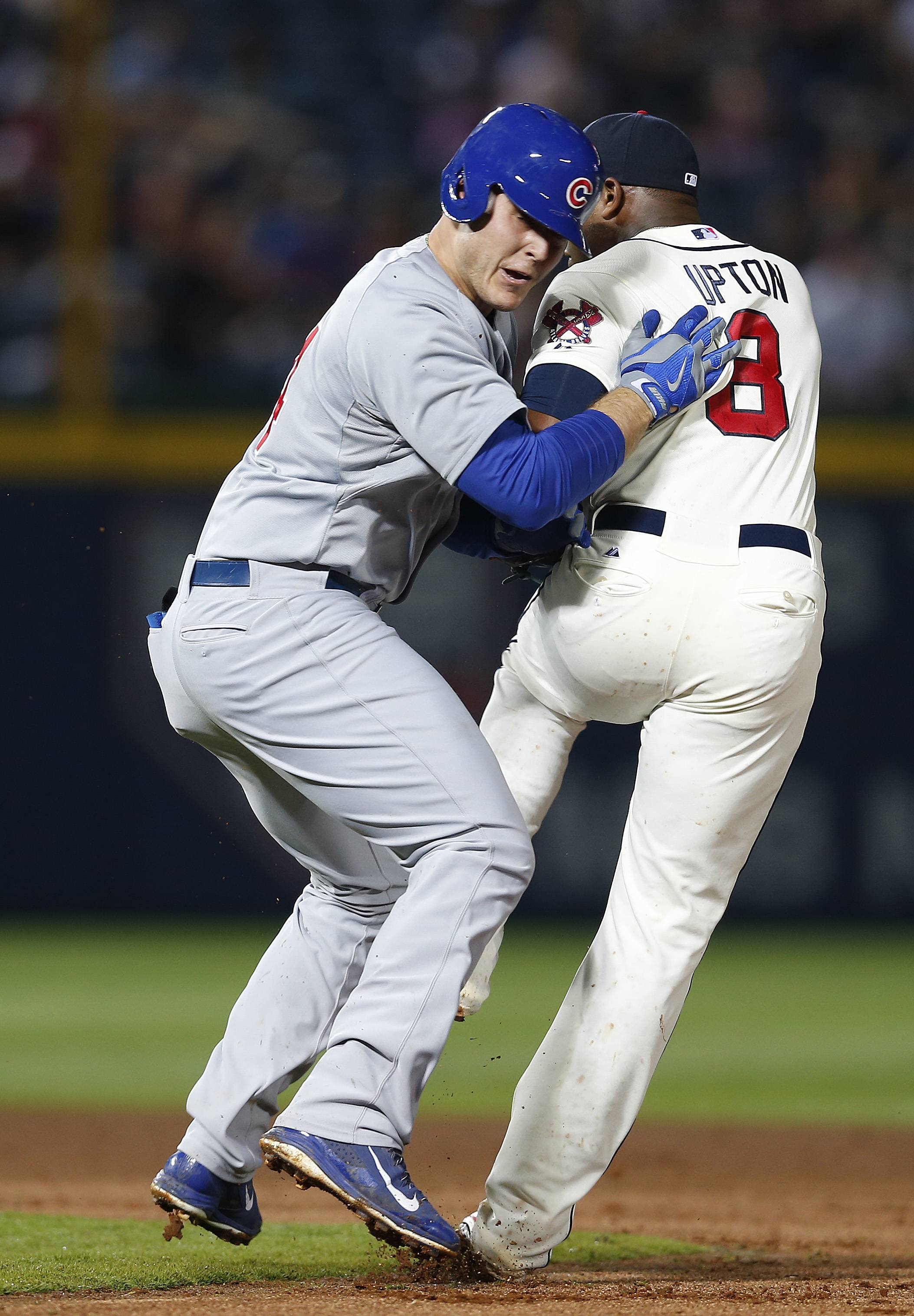 Braves left fielder Justin Upton tags out the Cubs' Anthony Rizzo after a rundown between first and second base in the fourth inning Saturday in Atlanta.