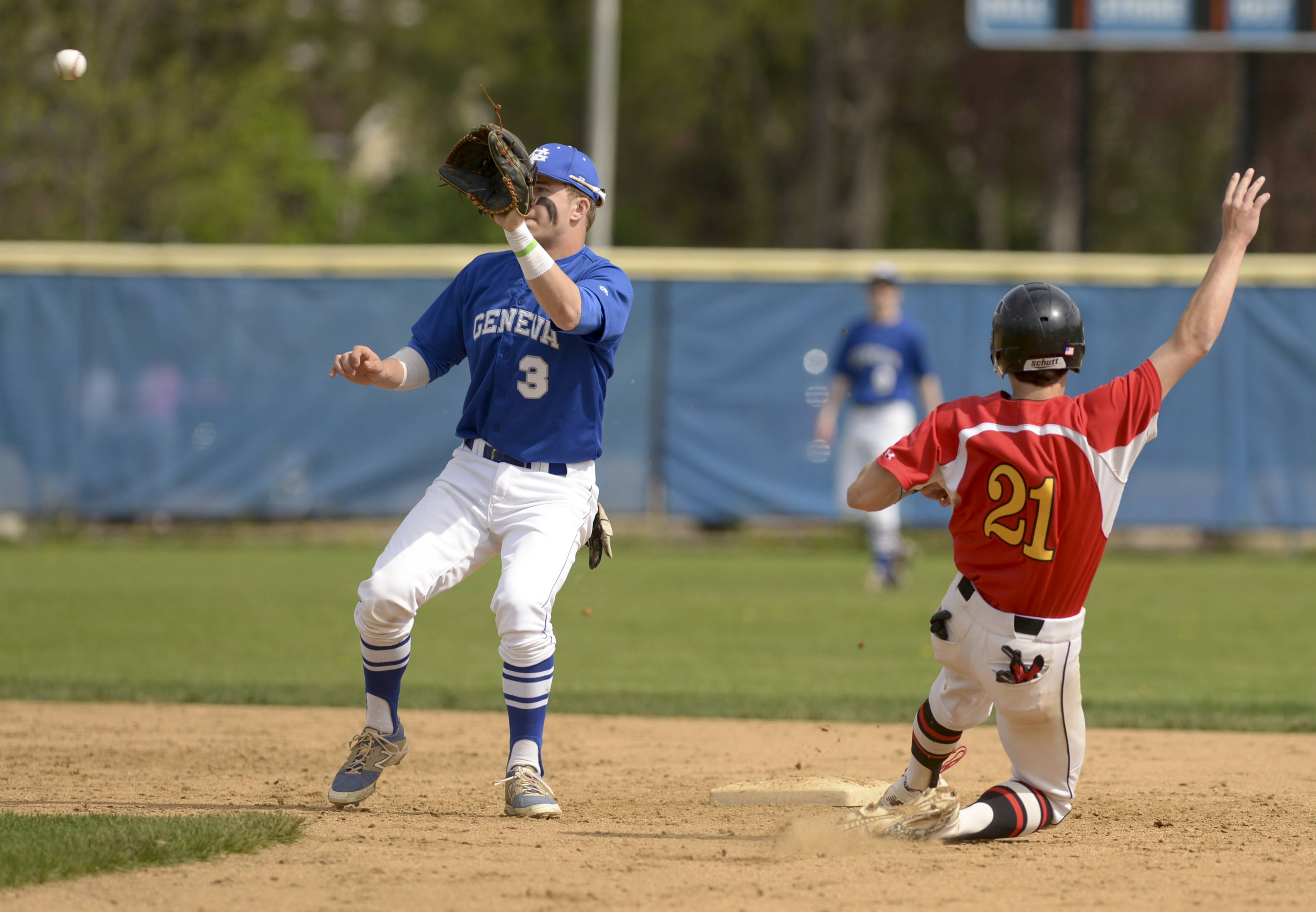 Geneva's Nick Derr come up shot as Batavia's Jeremy Schoessling slides safely into second, during baseball in Geneva Saturday.