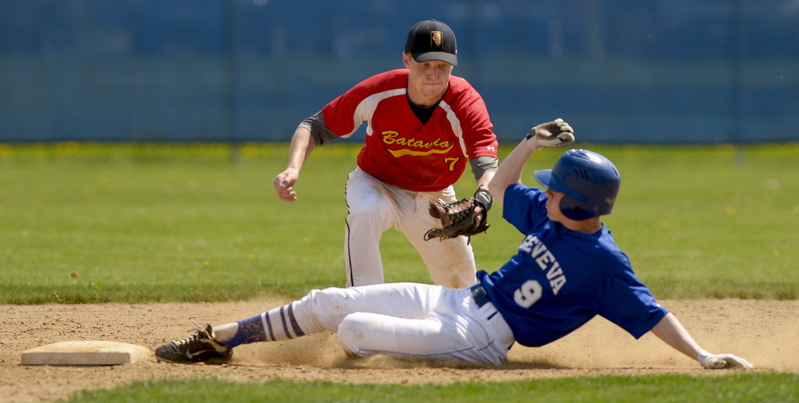 Geneva's Nick Fitzmaurice beats the tag from Andrew Siegler.