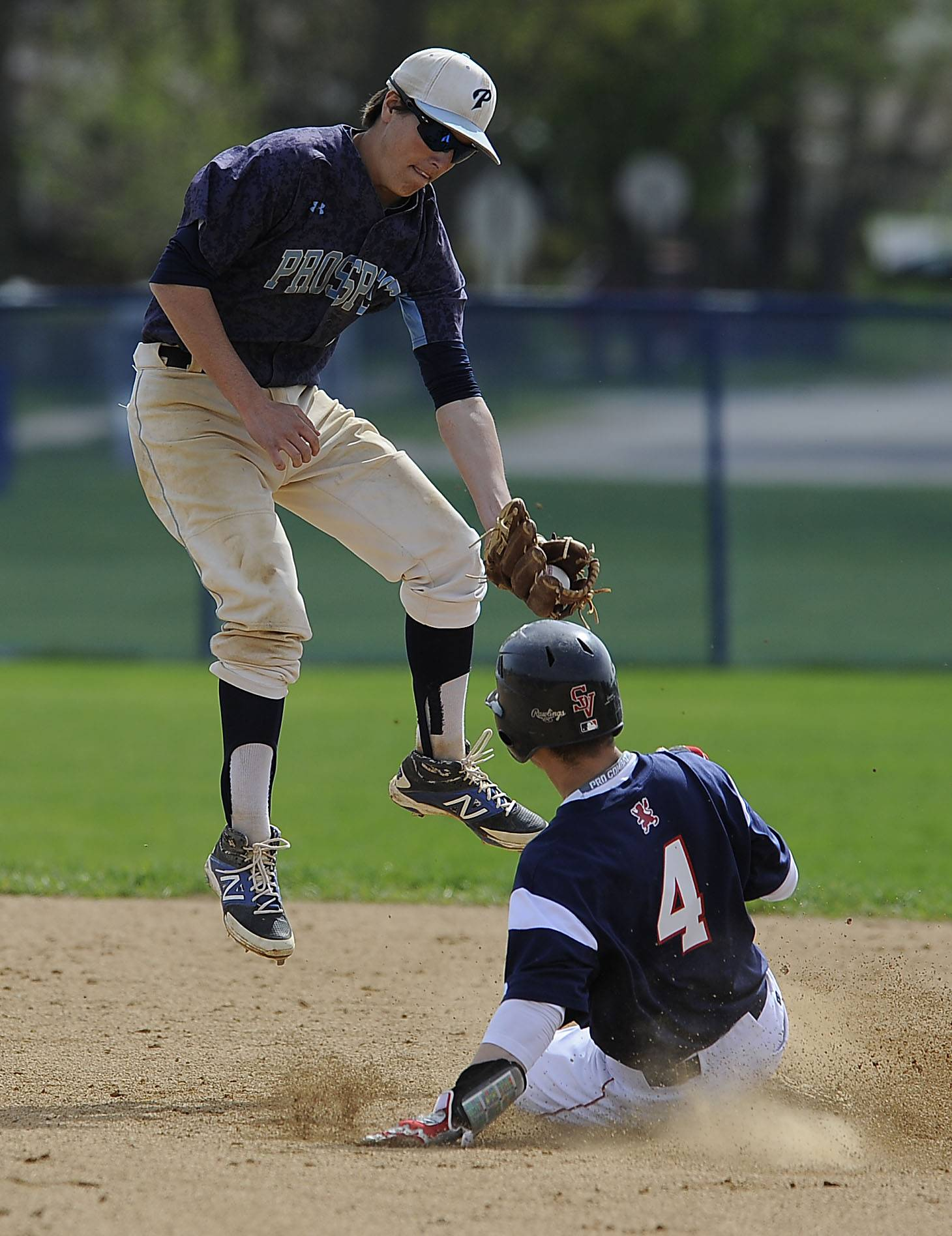 St. Viator's Matt Prazuch steals second base in the first inning as Prospect's Jake Cavaiani takes the throw at Prospect on Saturday.