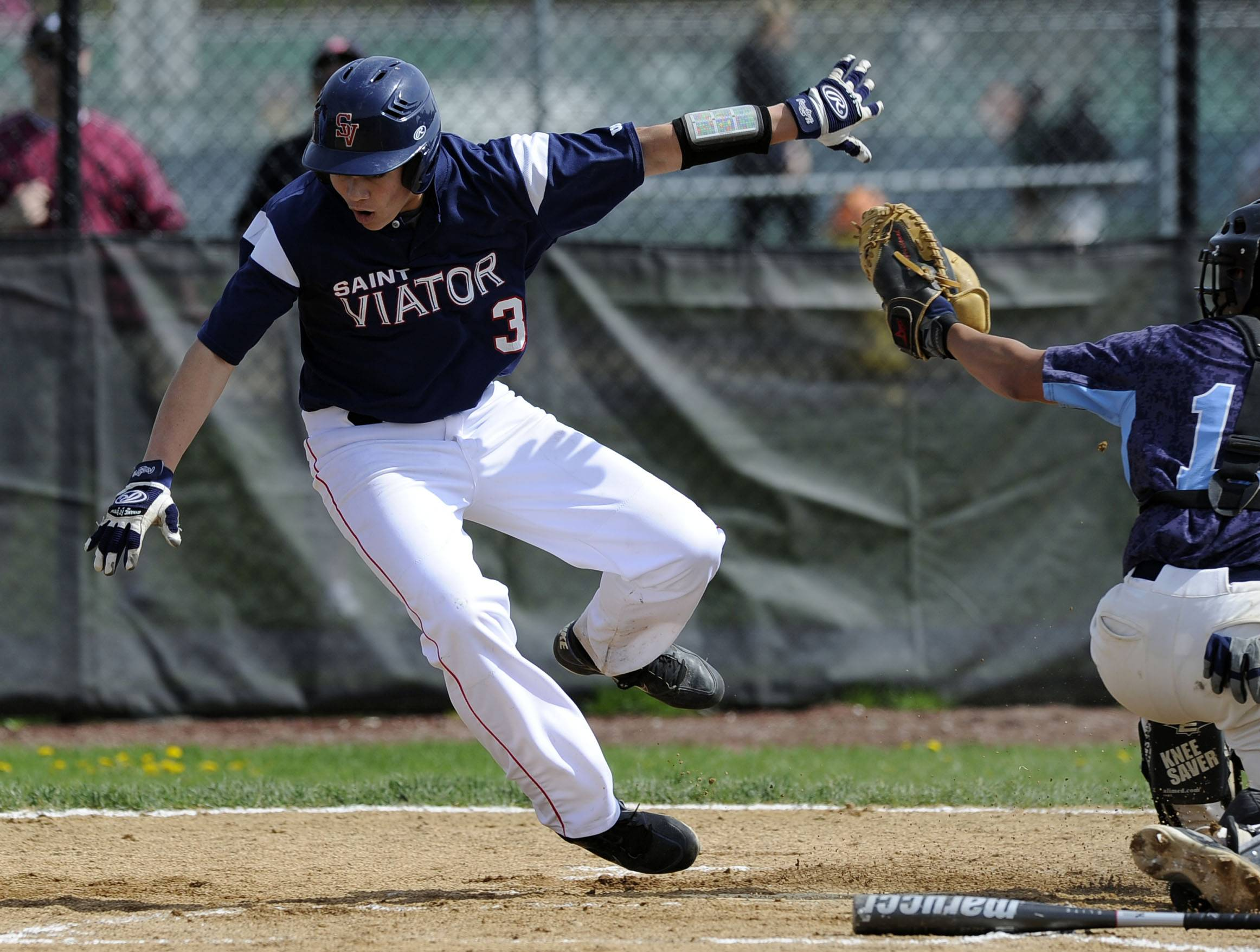 St. Viator's Jack Napoleon is tagged out at home by Prospect catcher Grant Miller on a squeeze attempt Saturday at Prospect.