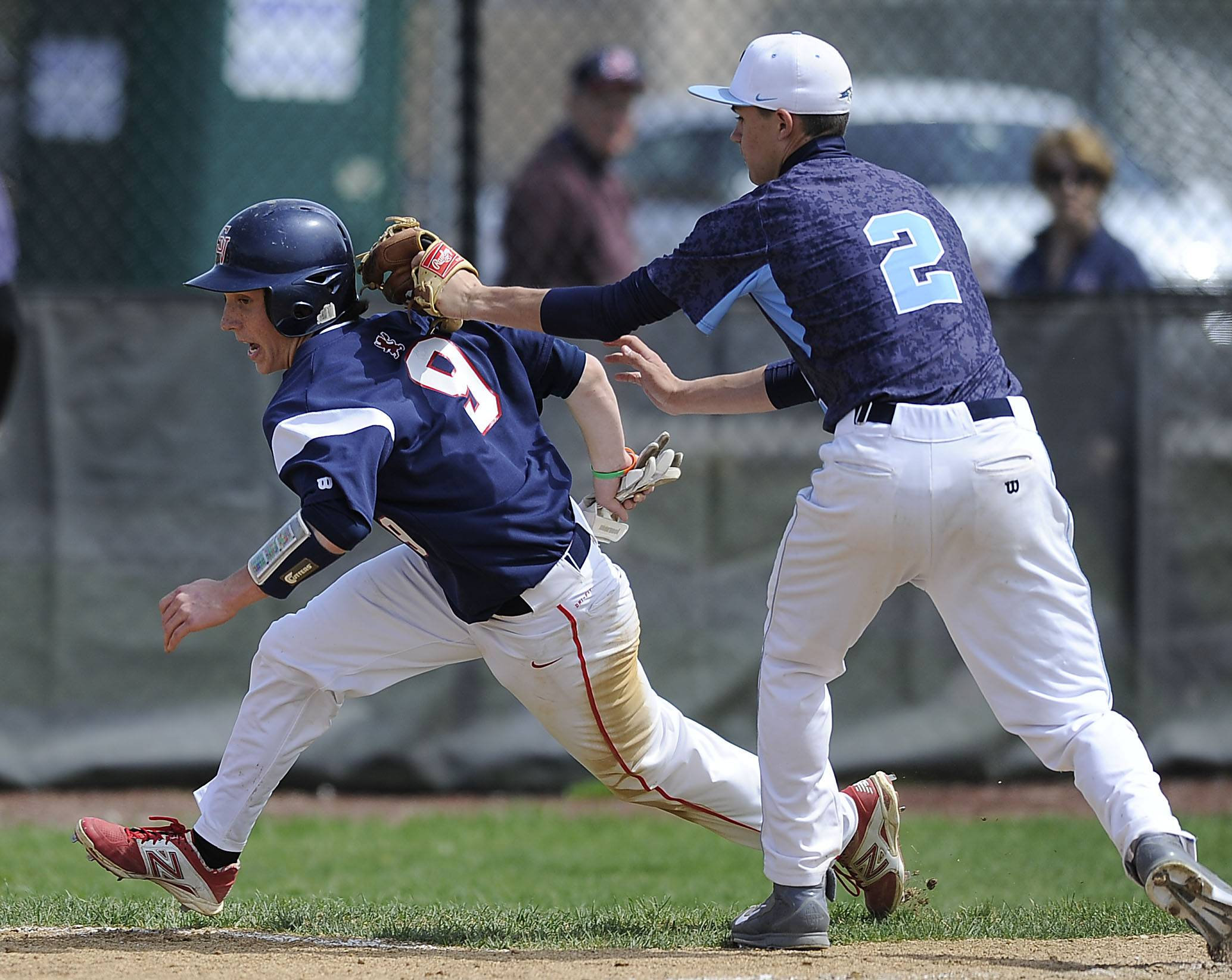 Prospect's Justin Placko tags out St. Viator's Matt Darling at the plate after a fourth-inning rundown at Prospect on Saturday.