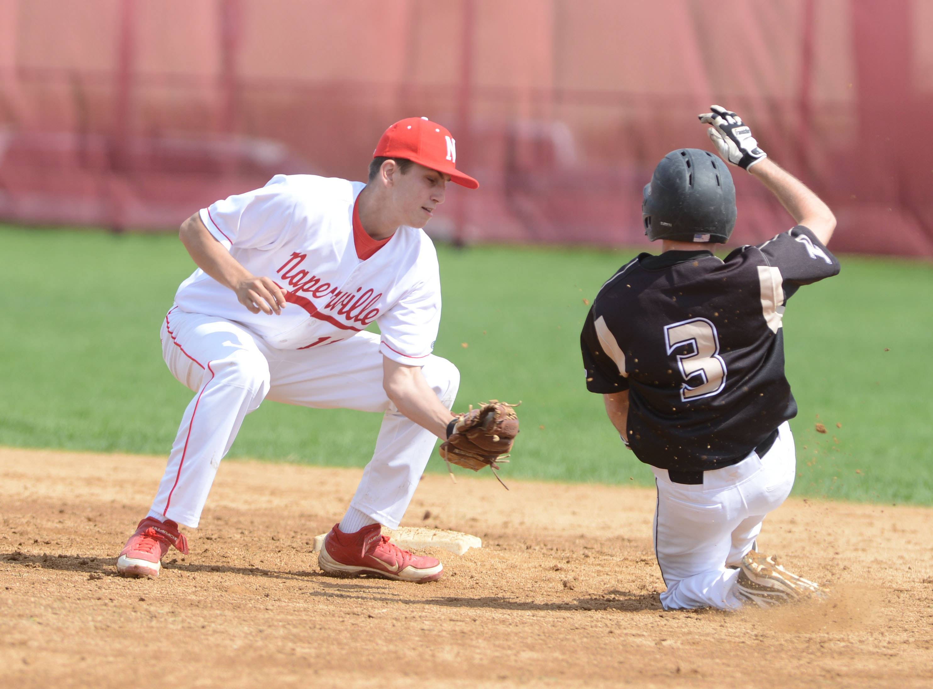 #11 of Naperville Central Michael Kolzow puts the tag on #3 Alex Barrett of Glenbard North during the Glenbard North at Naperville Central baseball game Saturday.  He was out.