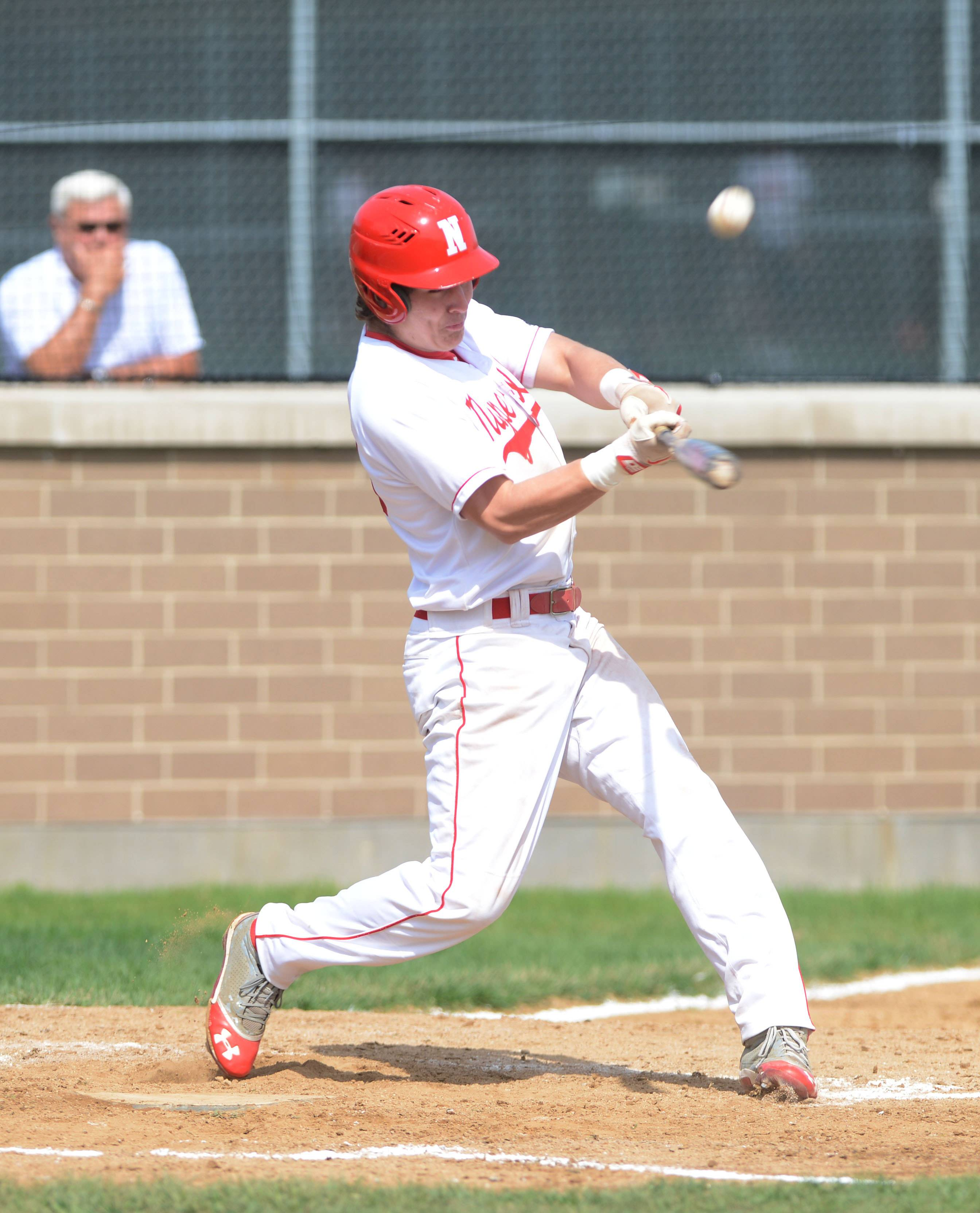 #33 Bob McMillen of Naperville Central takes a cut during the Glenbard North at Naperville Central baseball game Saturday.