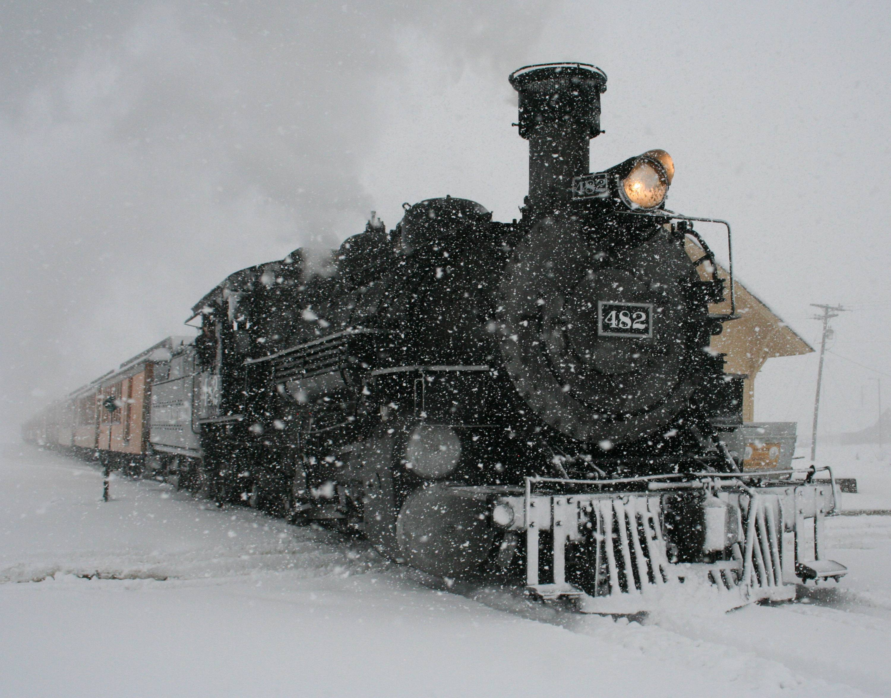 A Durango & Silverton Narrow Gauge Railroad passenger train arrives in Silverton, Colo., Sunday in the midst of a severe snowstorm that dropped more than a foot on the San Juan Mountains of southwest Colorado.