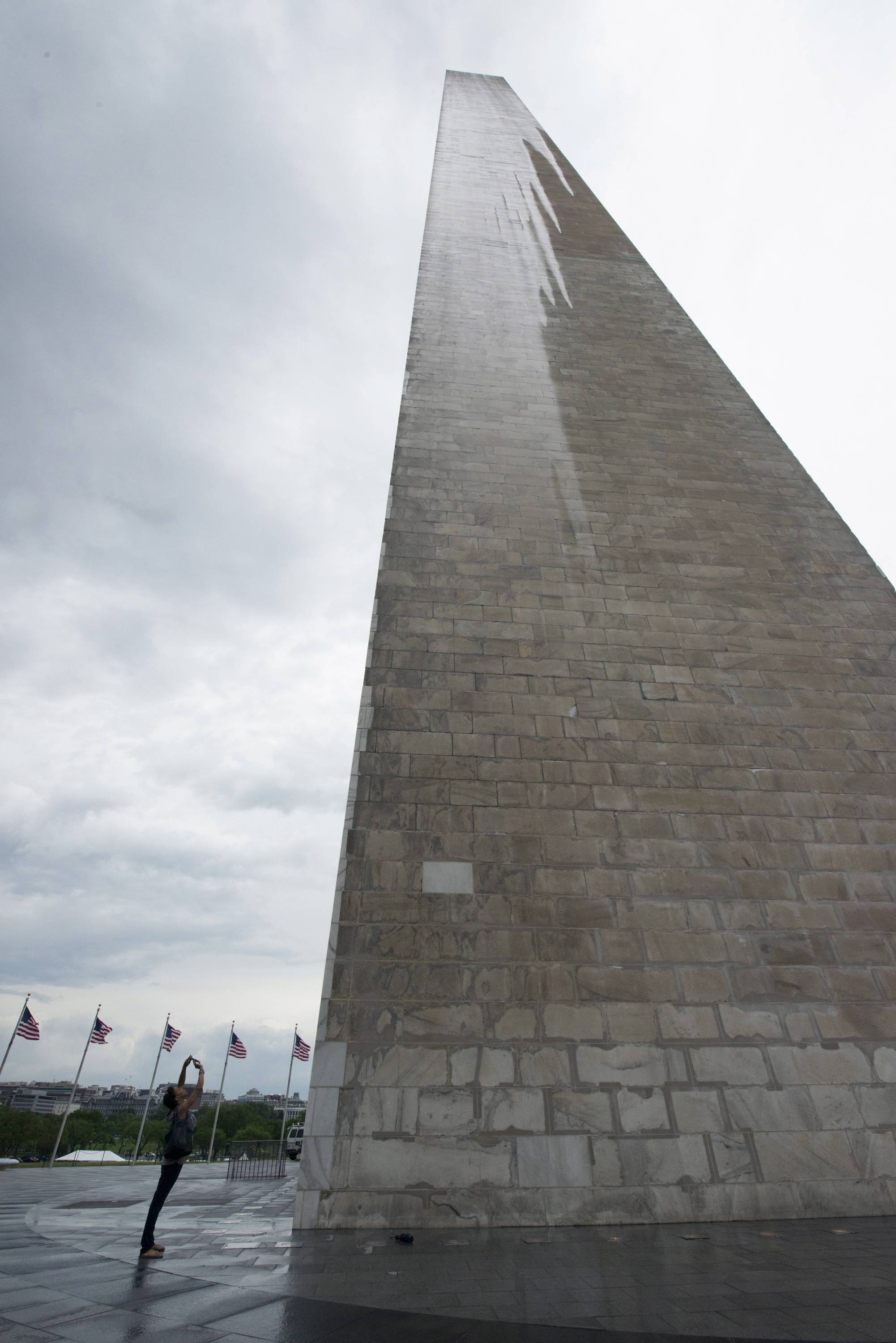 A journalist photographs the Washington Monument during a press preview prior to the re-opening of the monument Saturday.