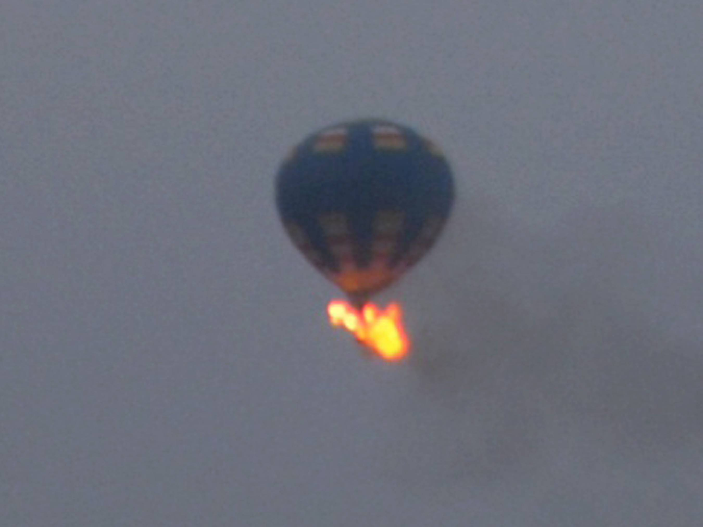 This photo provided by Nancy Johnson shows what authorities say is a hot-air balloon that was believed to have caught fire and crashed Friday.