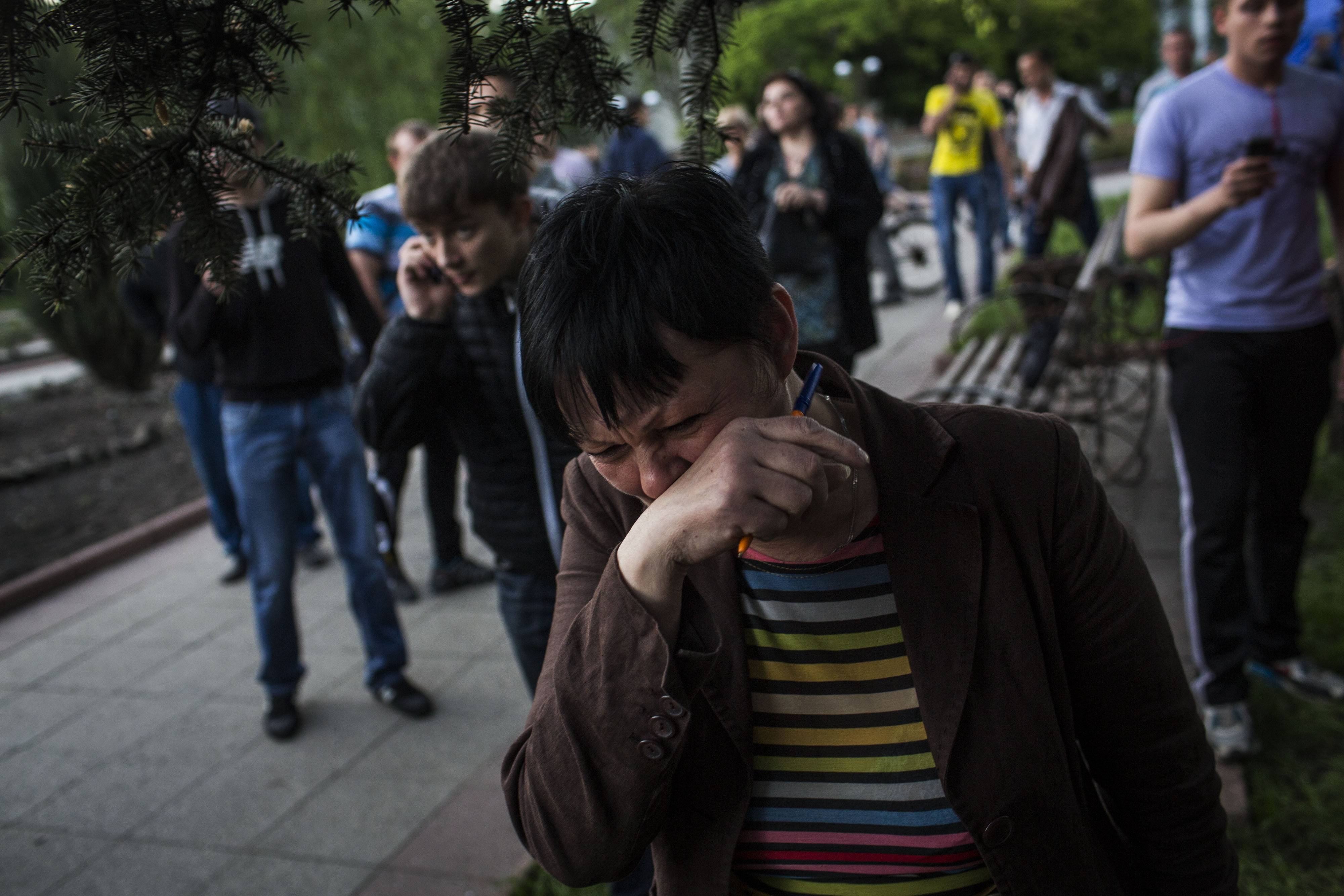 A woman reacts after Ukrainian national guardsmen opened fire on a crowd outside a town hall in Krasnoarmeisk, about 20 miles from the regional capital, Donetsk, Ukraine, Sunday.