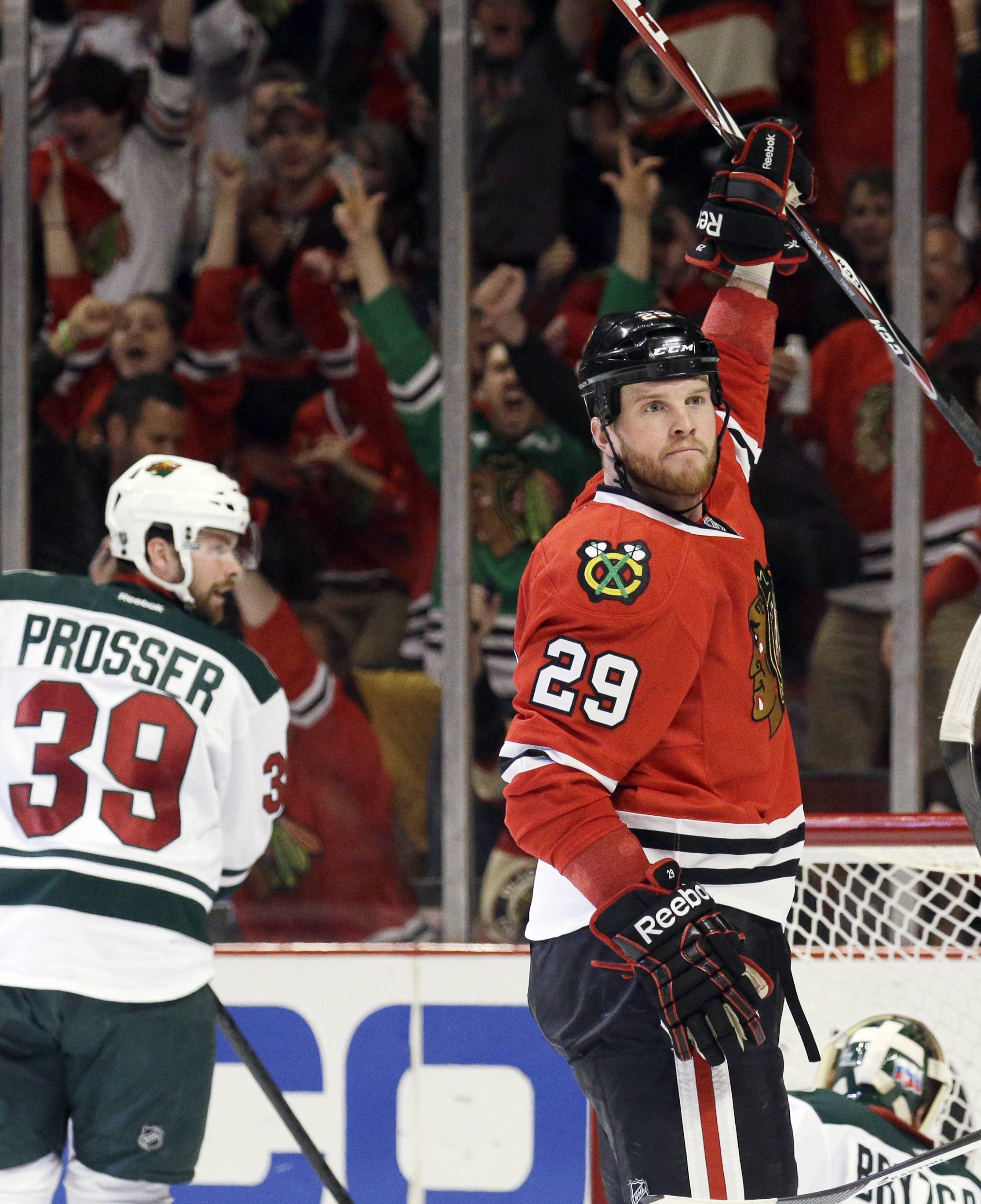 Blackhawks forward Bryan Bickell celebrates after scoring his second-period goal as the Minnesota Wild's Nate Prosser reacts Sunday at United Center.