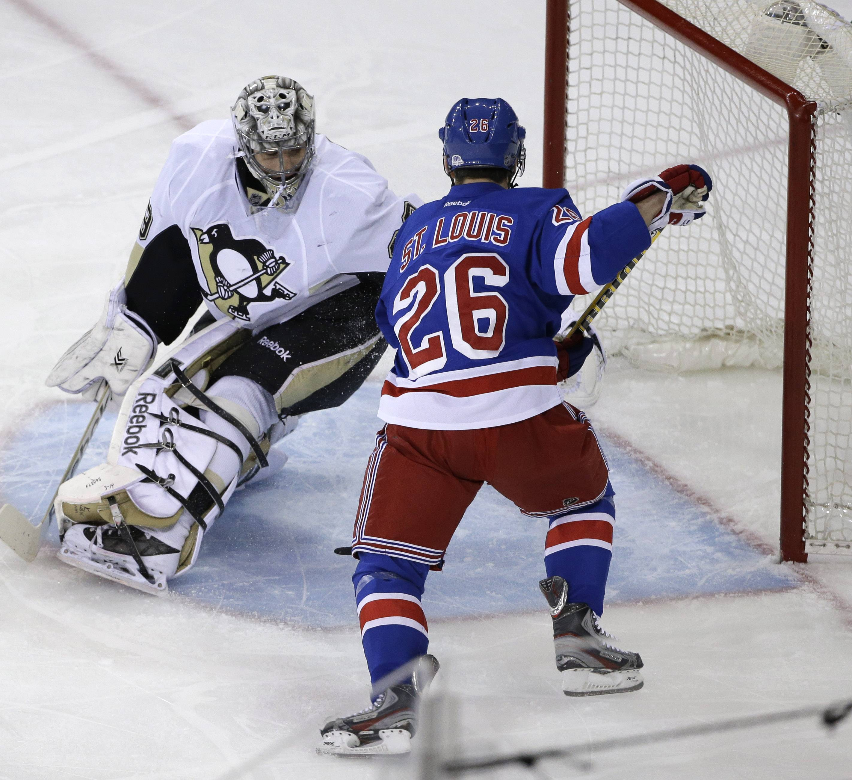 New York Rangers right wing Martin St. Louis (26) scores against Pittsburgh Penguins goalie Marc-Andre Fleury during the first period of Game 6 of a second-round NHL playoff hockey series on Sunday, May 11, 2014, in New York.