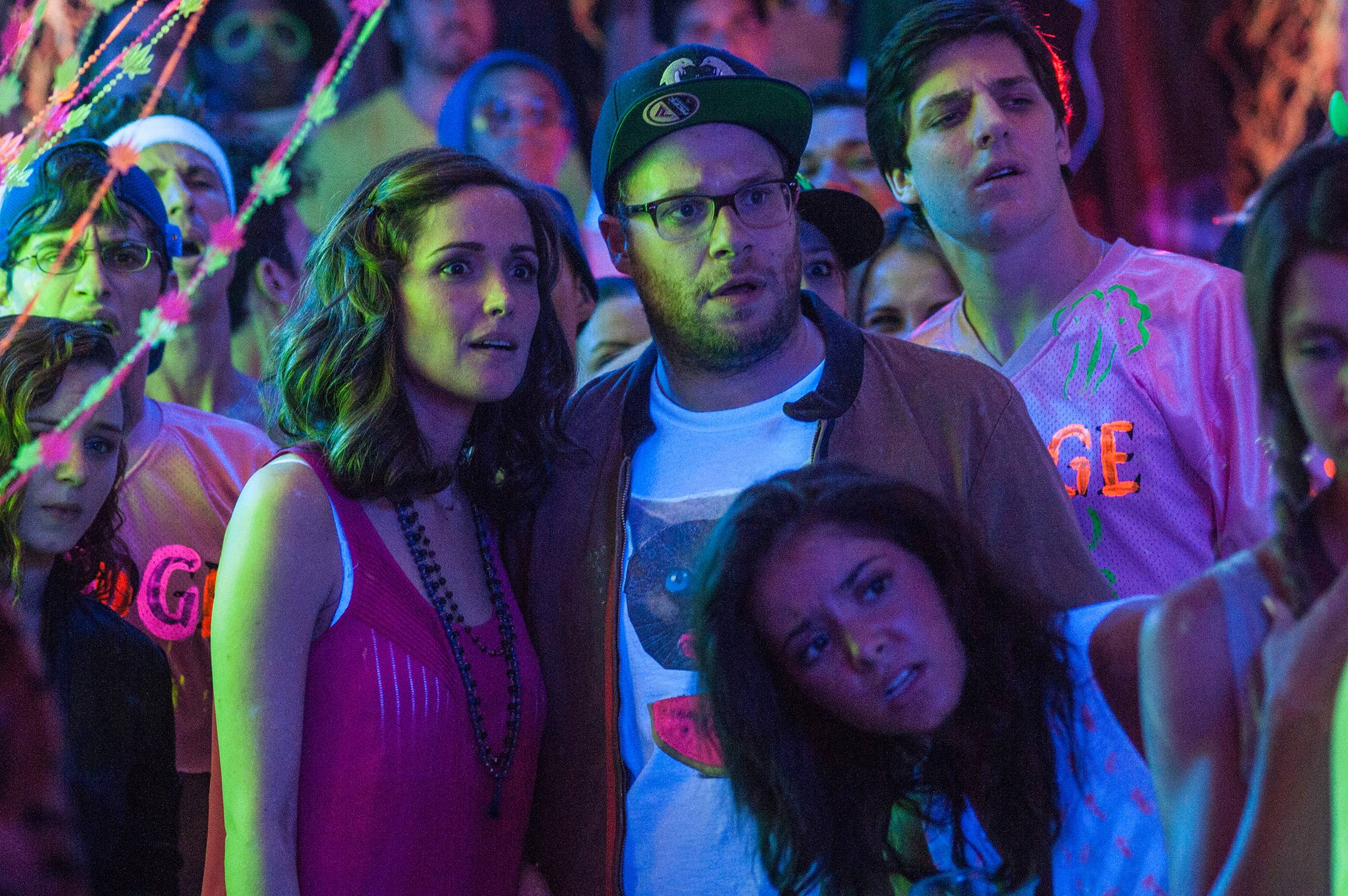 "This image released by Universal Pictures shows Rose Byrne, left, and Seth Rogen in a scene from the film, ""Neighbors,"" which beat out the ""Spider-Man"" sequel for the No. 1 box office spot."