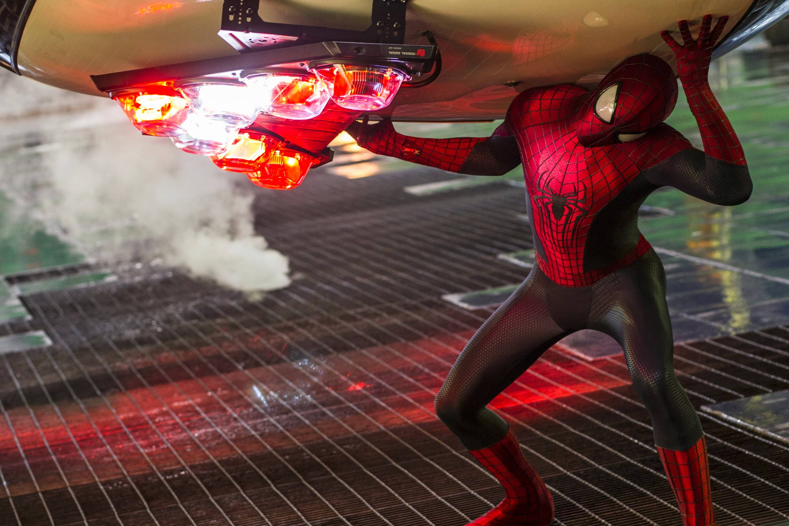 "New York's most popular web-slinger (Andrew Garfield) begins to show signs of strain in ""The Amazing Spider-Man 2,"" which fell to the No. 2 spot at the box office behind the Seth Rogen comedy ""Neighbors."""