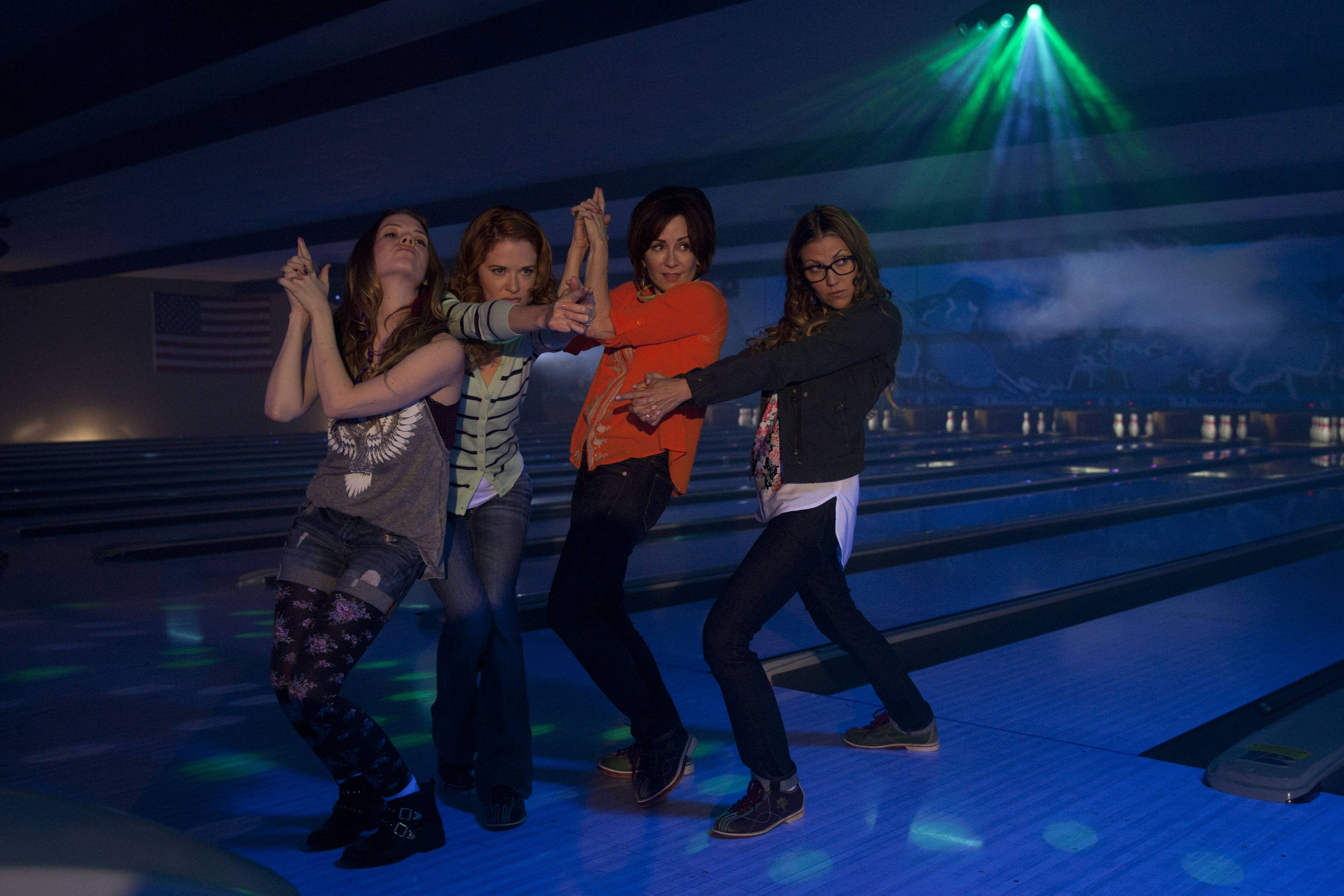 "Abbie Cobb, left, Sarah Drew, Patricia Heaton and Andrea Logan White play moms on a mission to have a good time in the family comedy ""Moms' Night Out."""