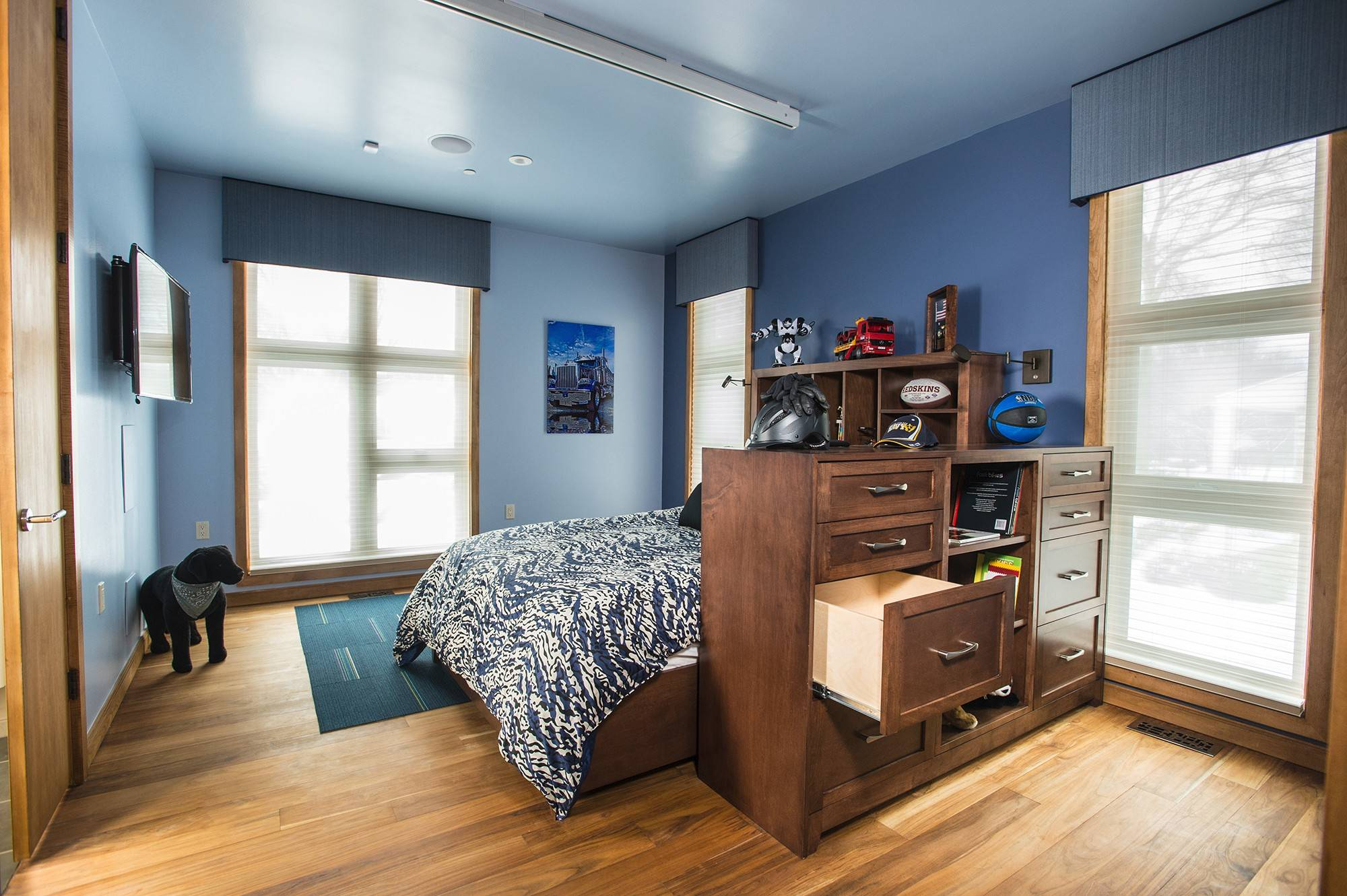 Joshua Cibula's room has an adjustable bed, iPad-controlled security and entertainment system, and track system. Drawers are set within Joshua's reach from his wheelchair.