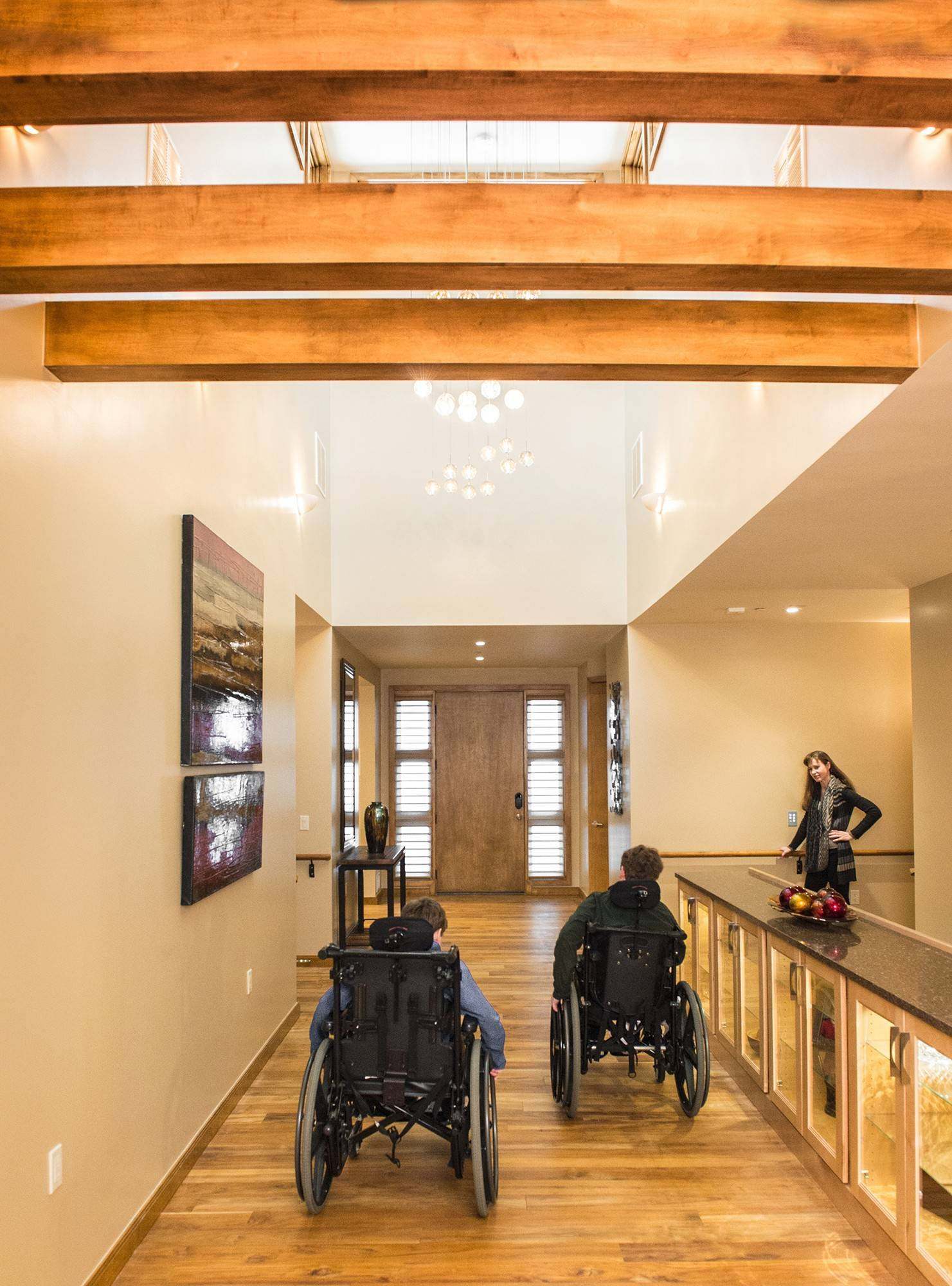 The main entry in the Cibulas' home is wide enough -- eight feet -- to allow both boys to travel side by side in their wheelchairs. At right is mother Jennifer Cibula.
