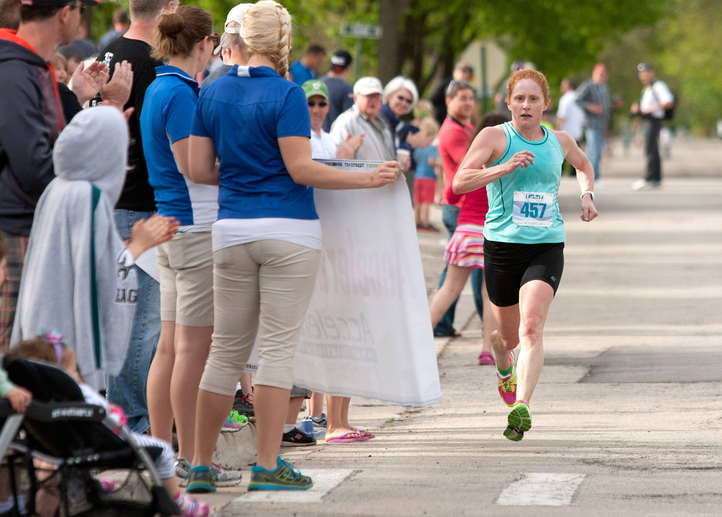 Jennifer Garrison of Naperville wins Sunday's Run Like a Mother 5K race in Hinsdale with a time of 18:36. The run raises money to enrich the lives of children with Angelman syndrome.