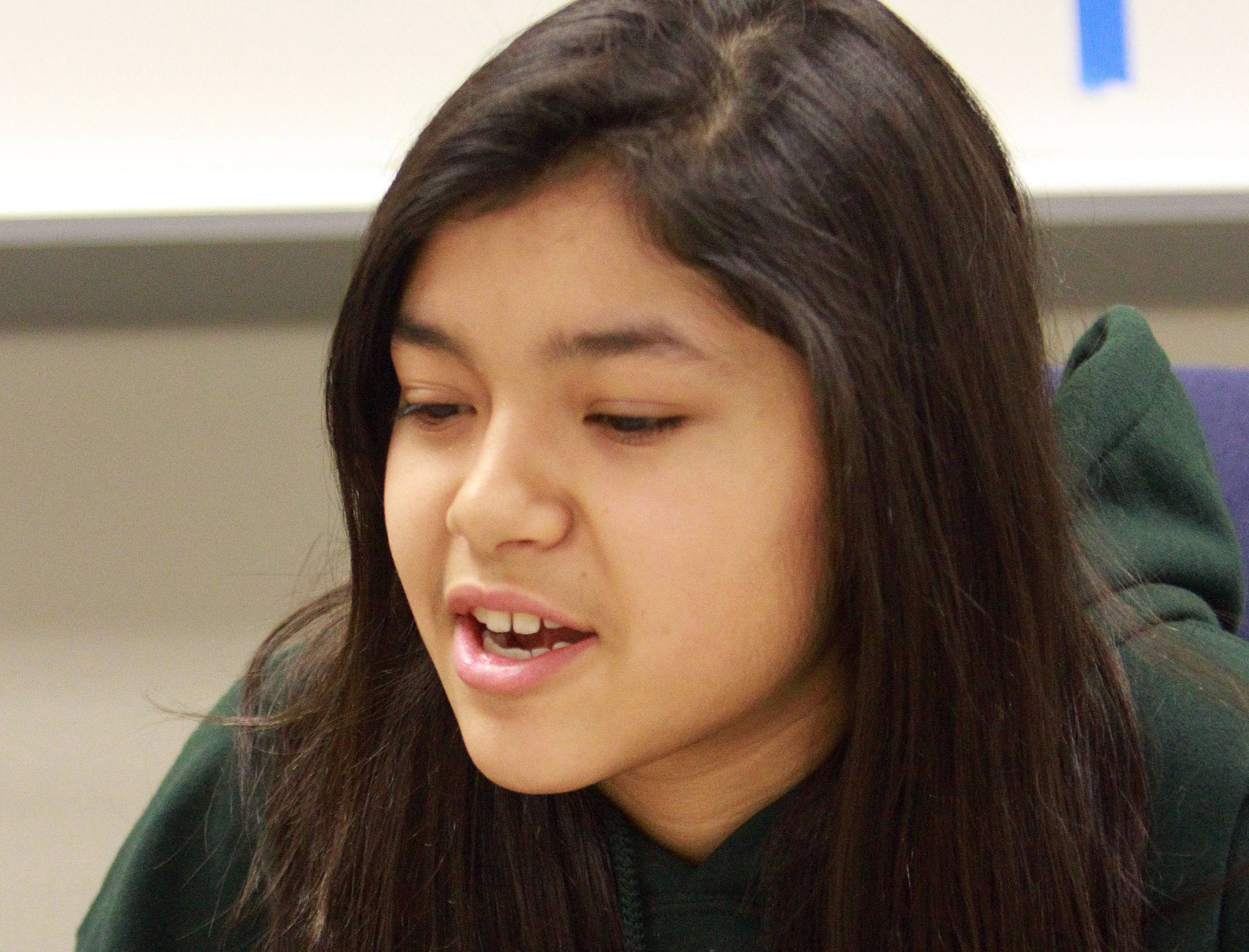 Round Lake Middle School eighth grader Allie Ramirez talks about her involvement in the Second Saturday program. Allie serves as a mentor to younger at-risk children through the program.