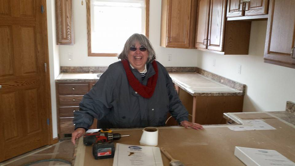 This is one of Political Editor Mike Riopell's favorite photos of his mother because it shows her in the house that will replace the one destroyed by last year's Washington tornado.