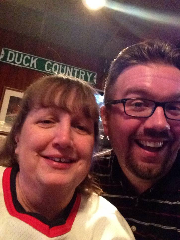 Columnist and copy editor Sean Stangland's mom, Bonnie Stangland, caught Hawks fever and surprised him by coming out to Sports Page in Arlington Hts. to watch Game 5 against St. Louis.