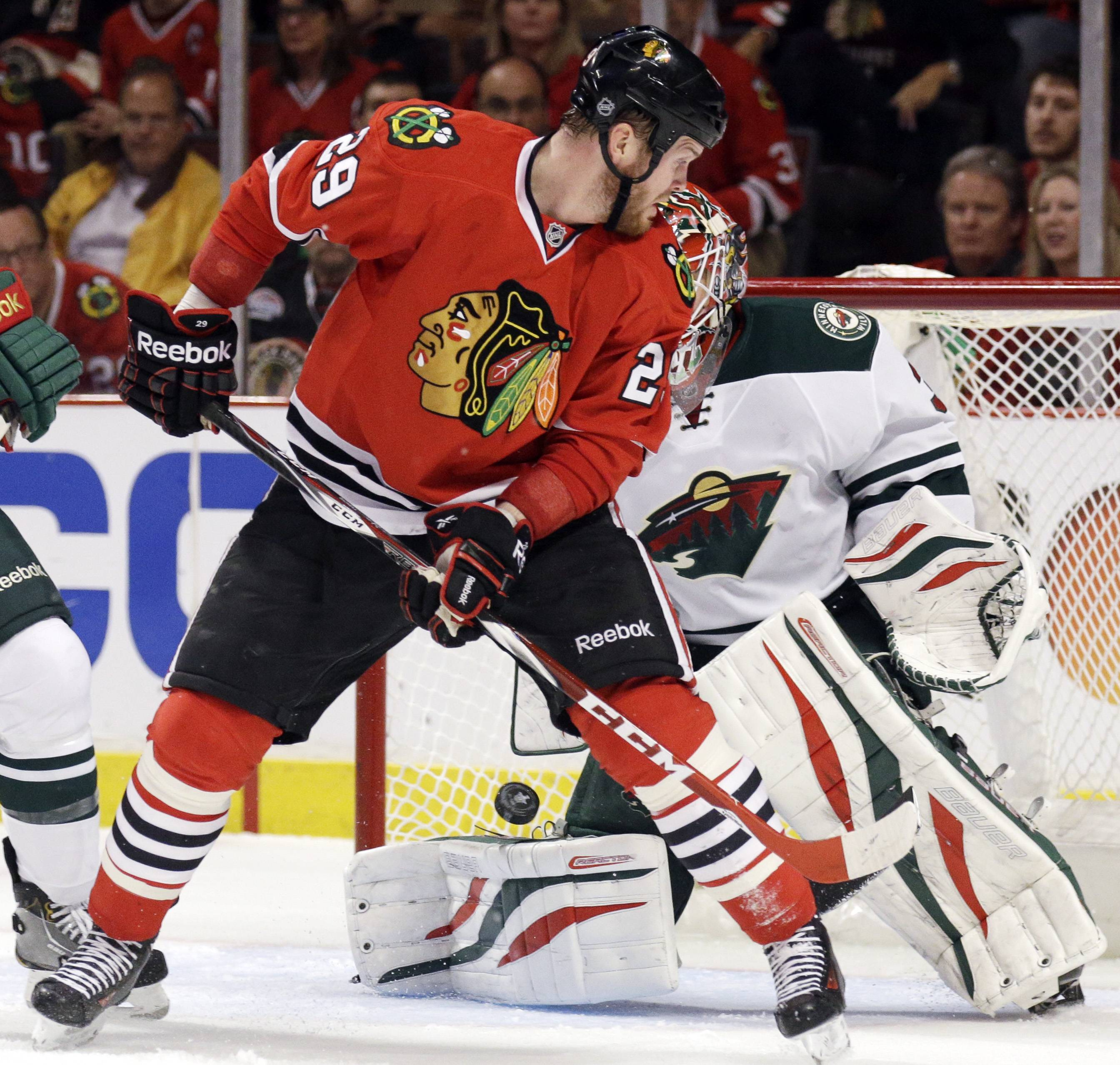 Chicago Blackhawks' Bryan Bickell (29) scores against Minnesota Wild goalie Ilya Bryzgalov (30) during the second period.