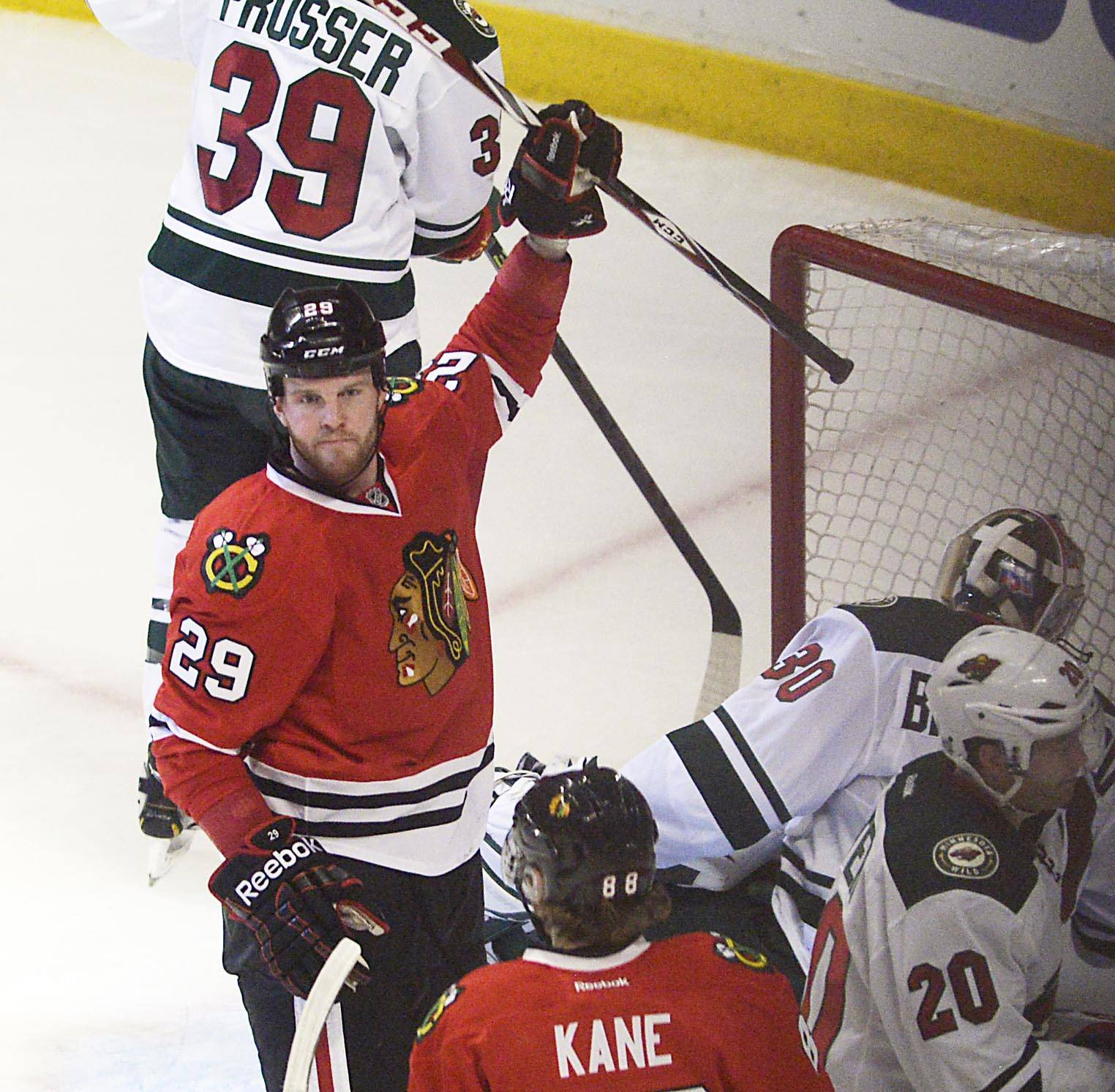 Chicago Blackhawks left wing Bryan Bickell raises his stick after his first period goal against the Minnesota Wild S.