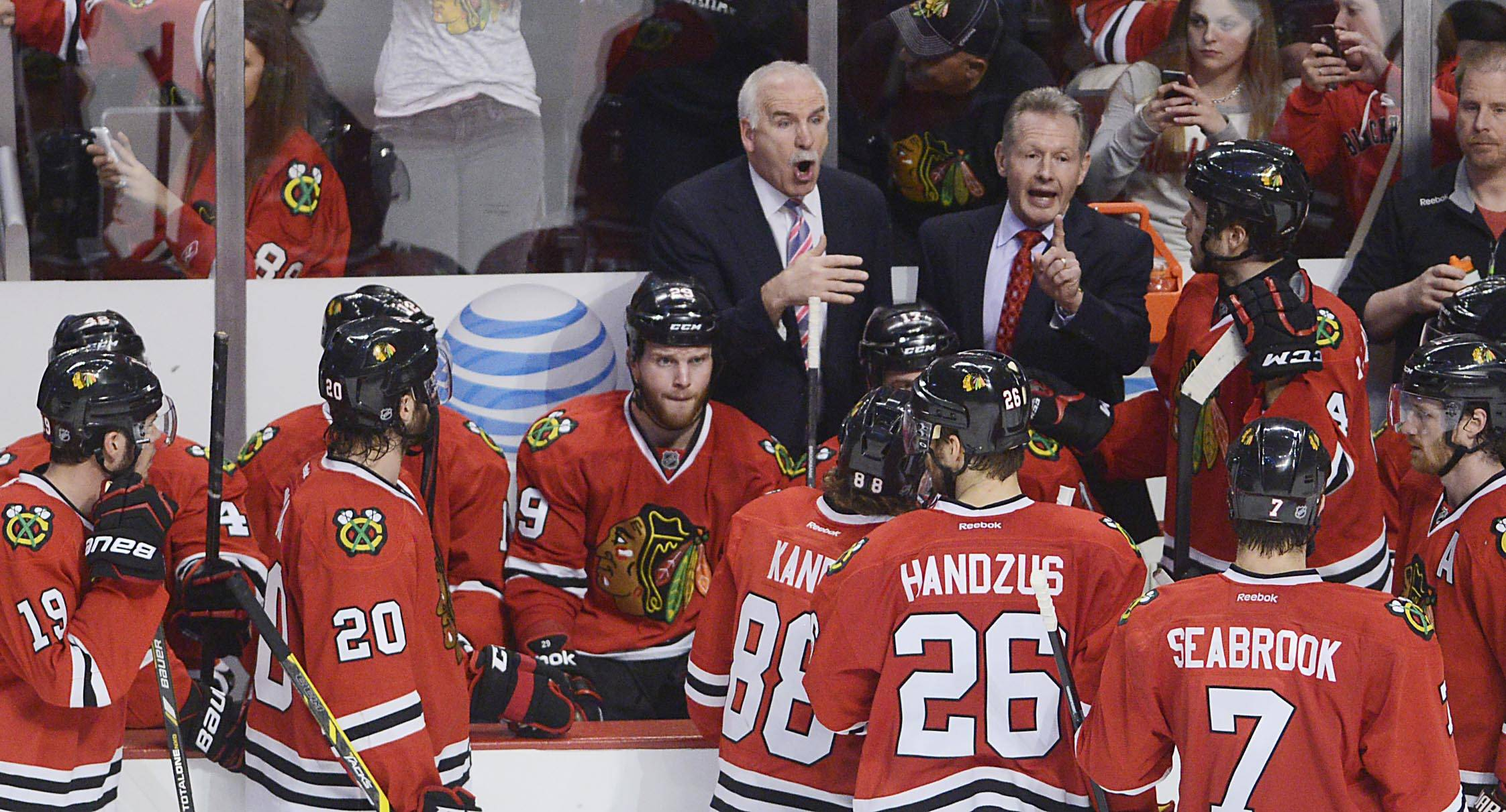 Chicago Blackhawks coach Joel Quenneville directs his team during a timeout with less than three minutes to play.
