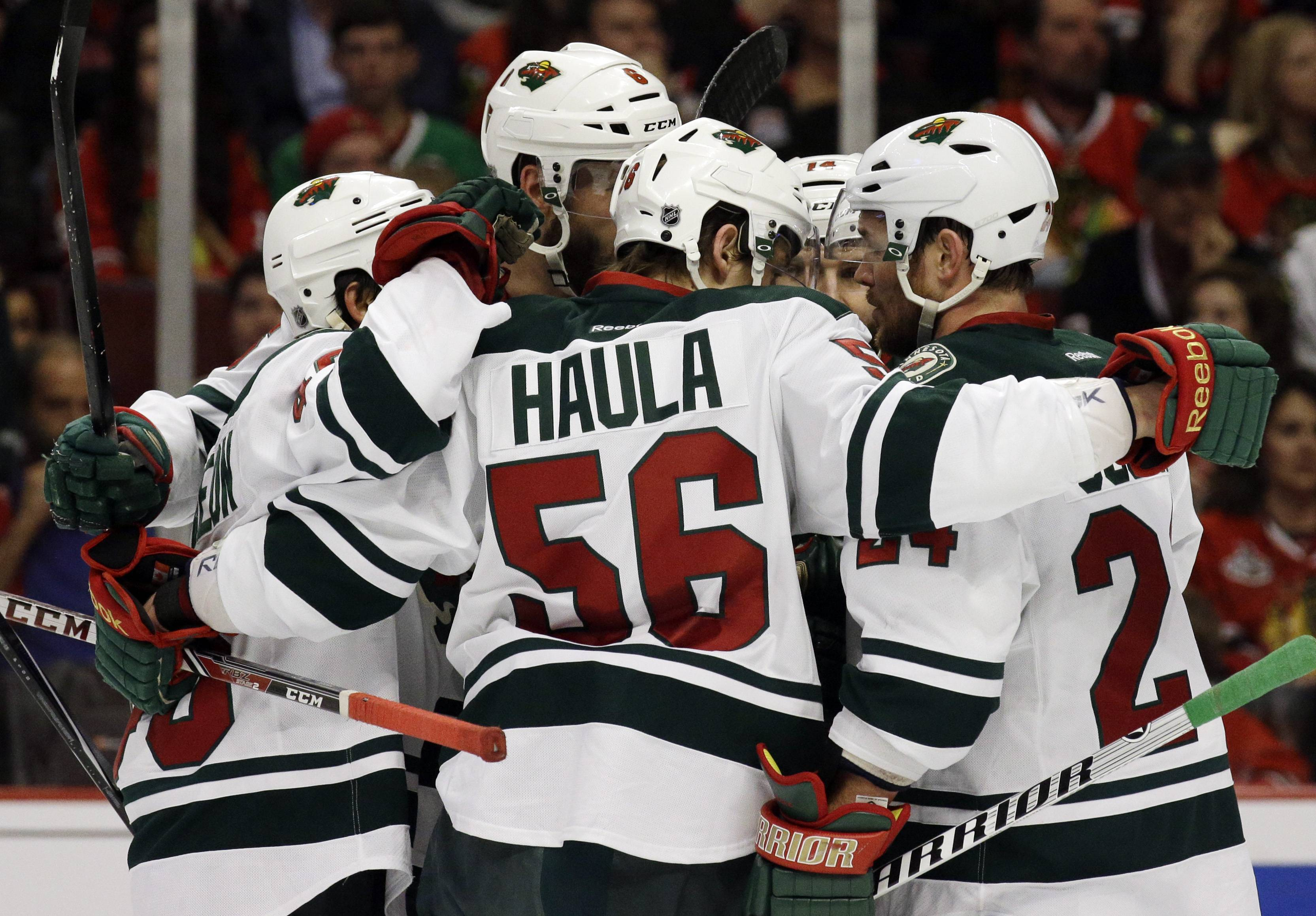 Minnesota Wild's Erik Haula (56) celebrates with teammates after scoring his goal against the Chicago Blackhawks during the first period.