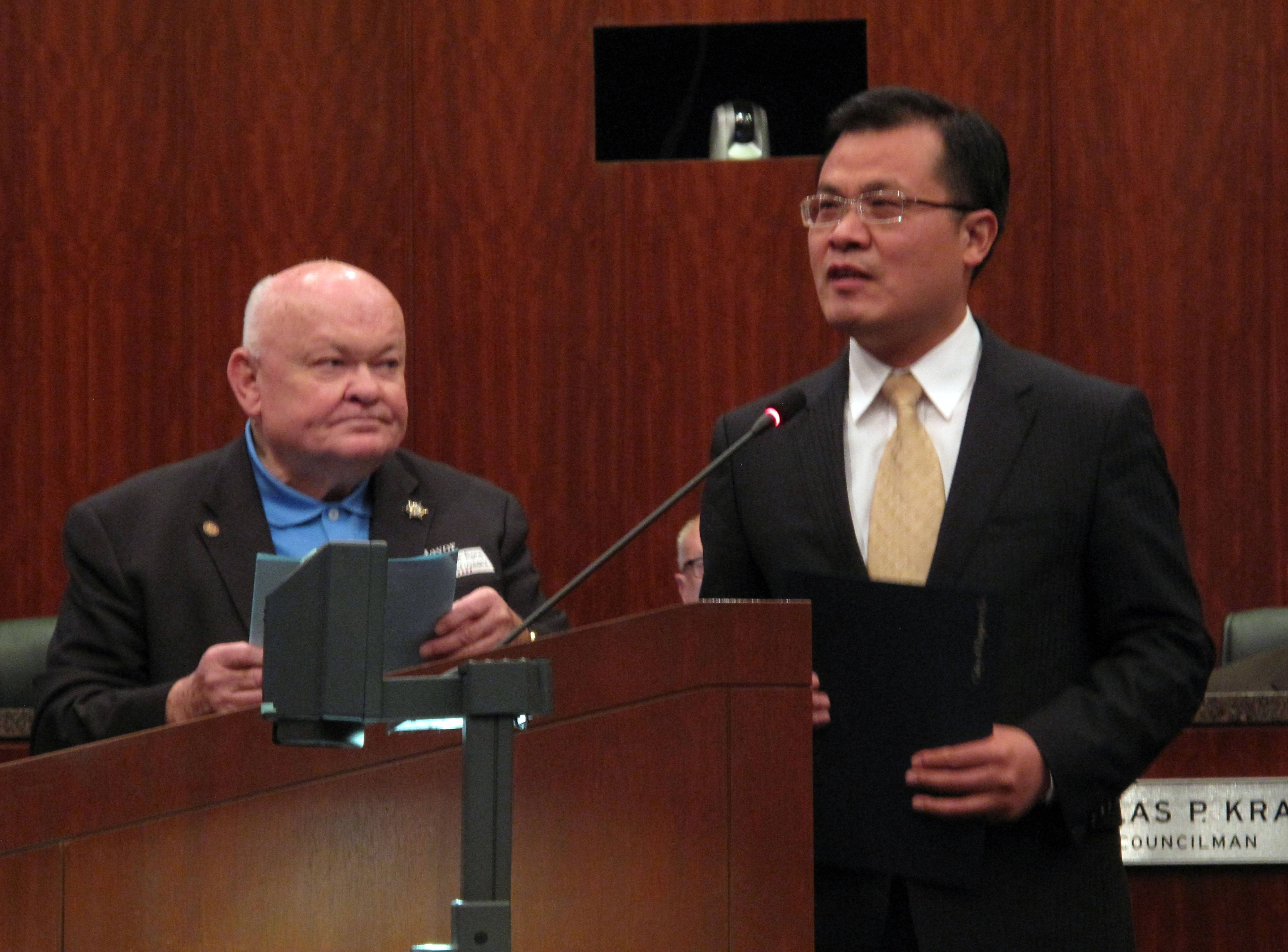 Zhao Weiping, Chinese Consul General for the Chicago district, accepts an honorary citizenship certificate from Naperville Mayor George Pradel. The city welcomed Weiping in an effort to promote friendship and business growth through the Chinese Community Outreach program.