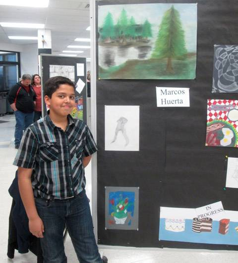 Marcos Huerta shows off his work at the Arts & Humanities Fair at Mundelein's Carl Sandburg Middle School.