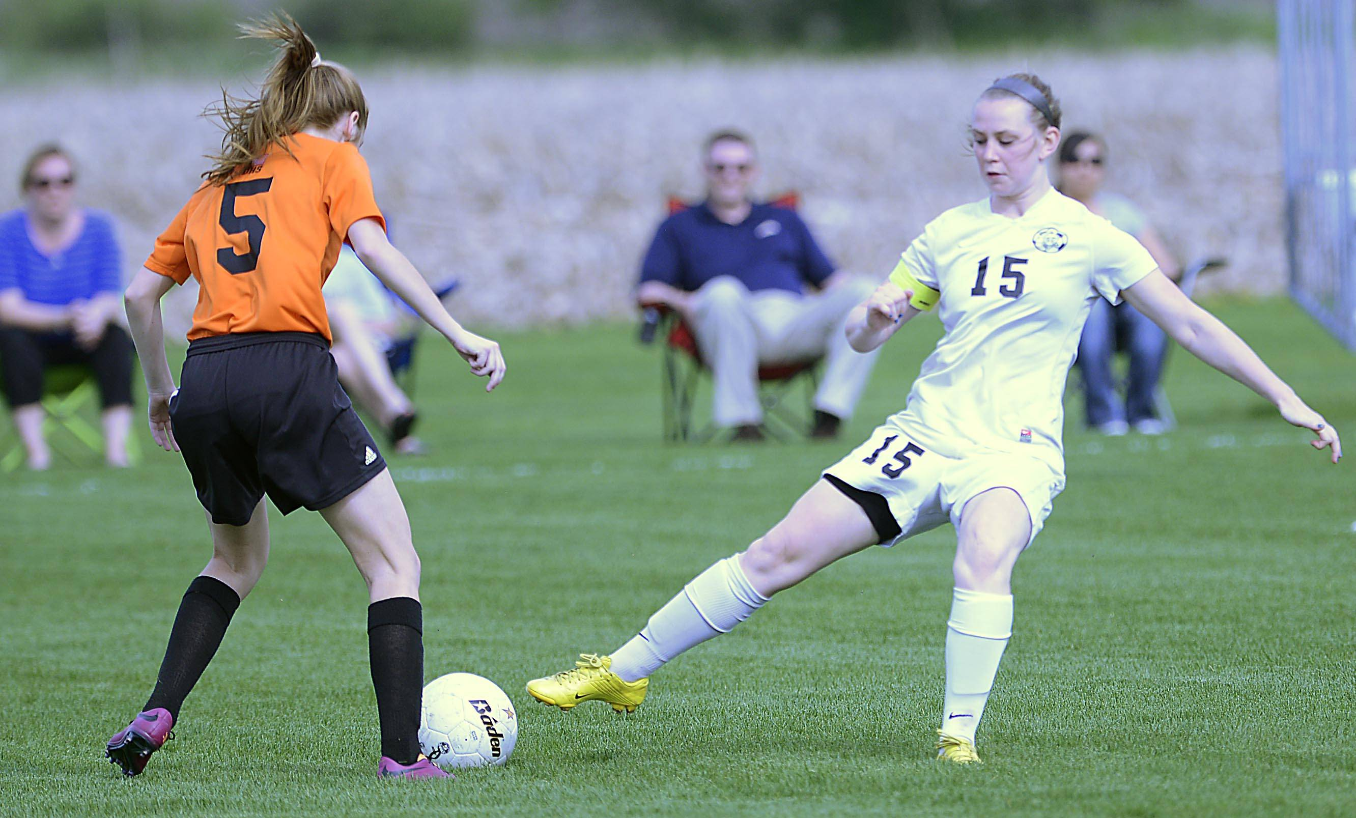 Kaneland's Brittany Olson punches the ball away from Dekalb.