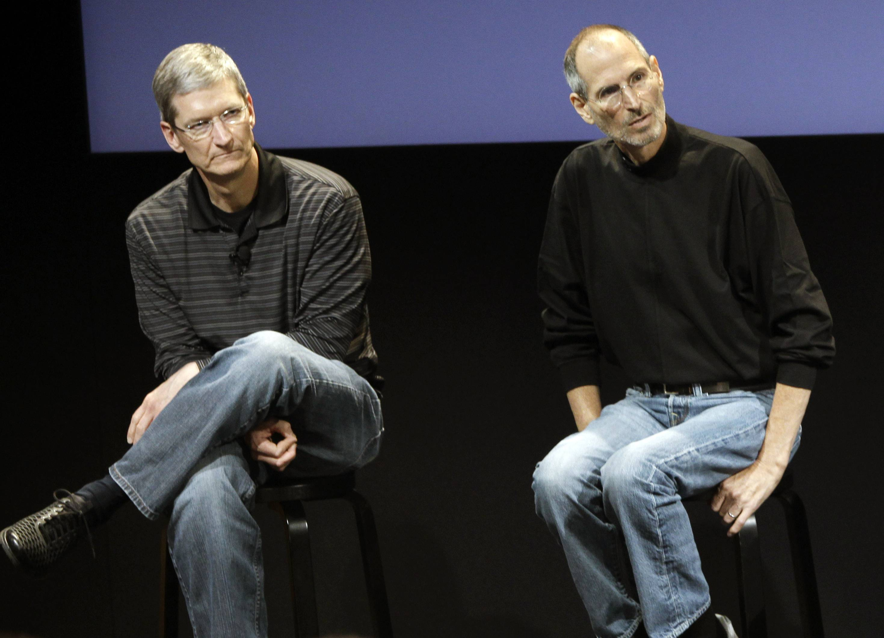 Tim Cook, left, and Steve Jobs lead a meeting at Apple in Cupertino, Calif. Since Jobs' death, Apple's pace of innovation has slowed.