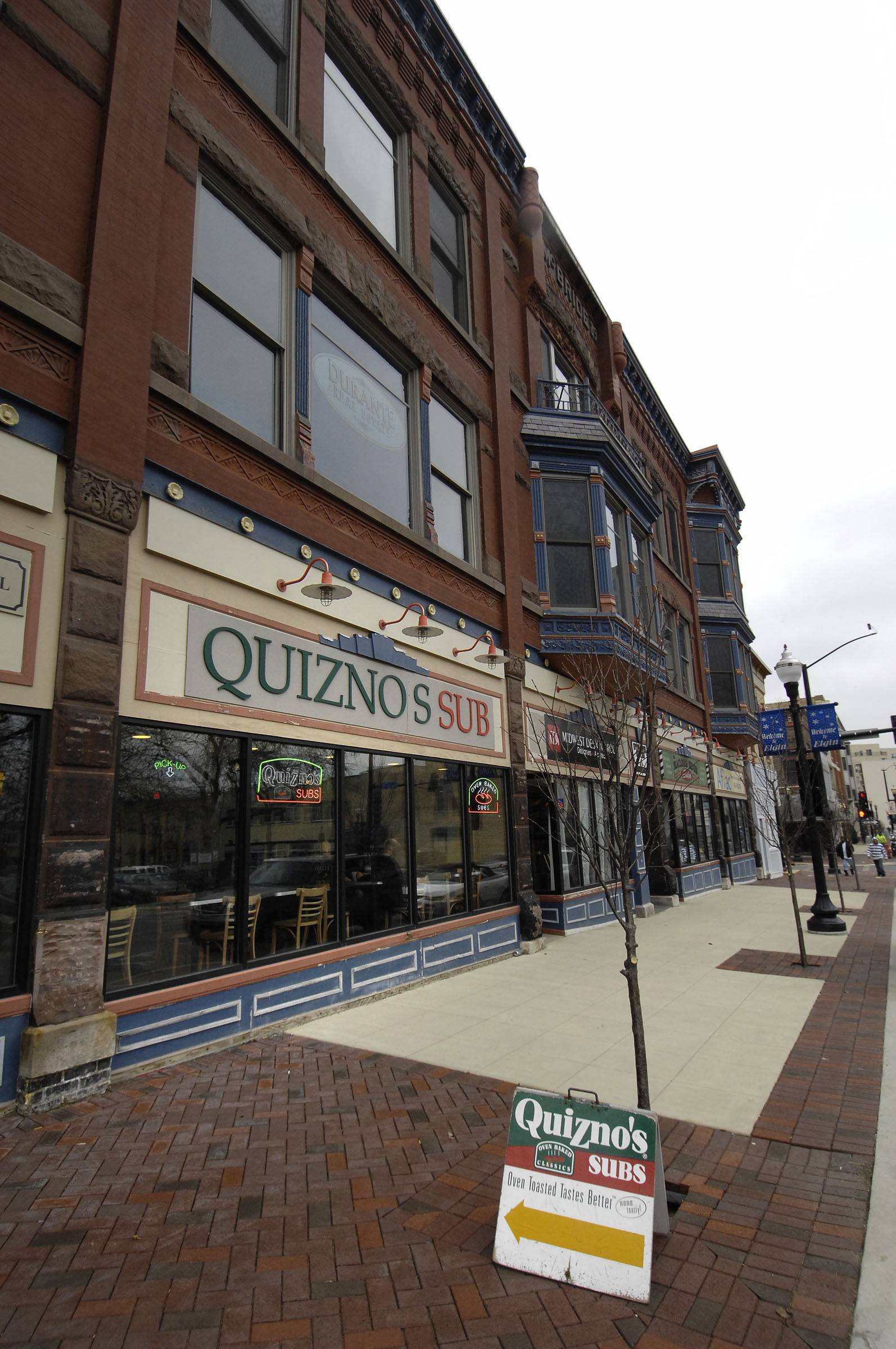 Quiznos Corp., the Denver-based toasted-sandwich chain that entered bankruptcy in March, received court approval of a recovery plan that cuts debt by more than $400 million.