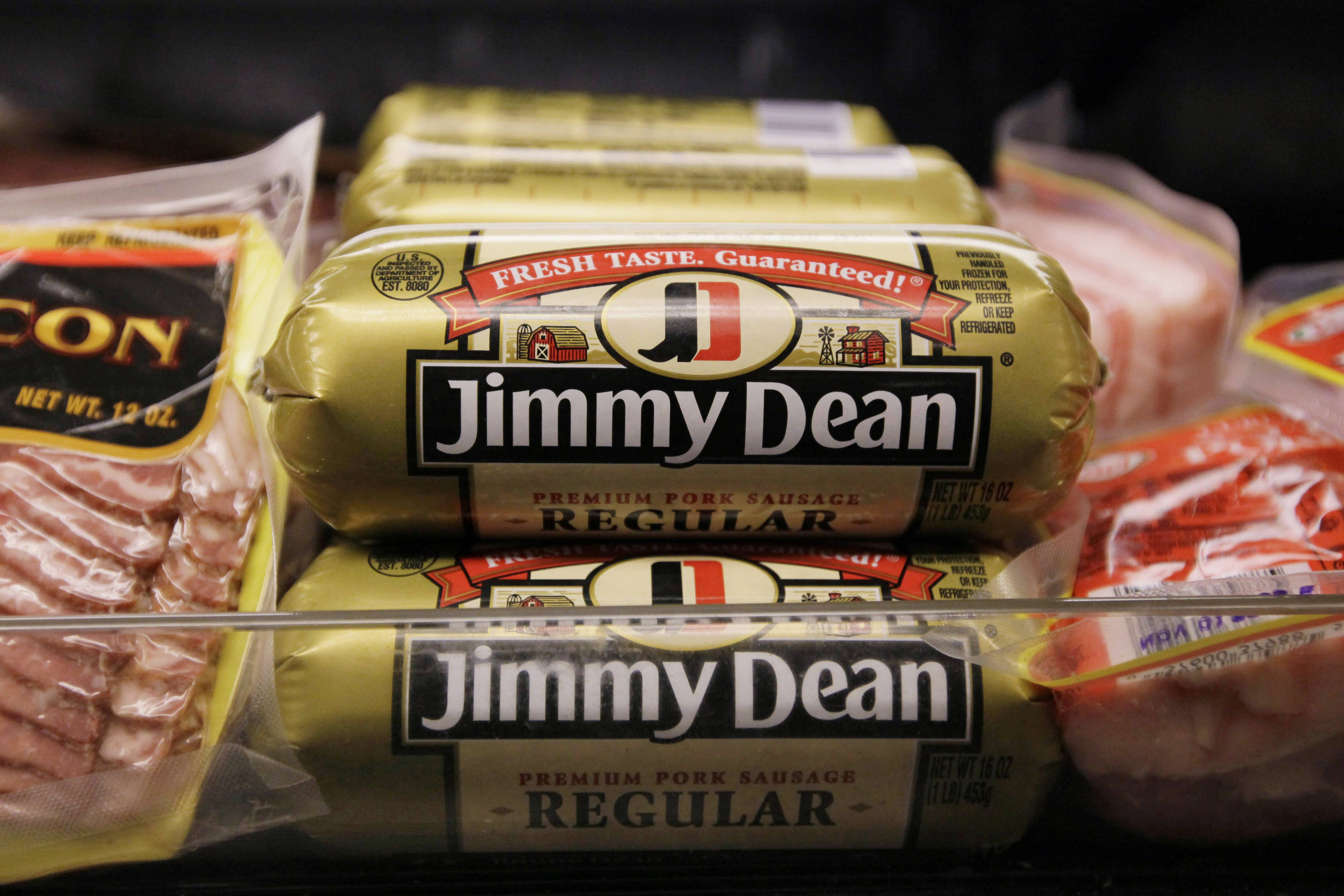 Hillshire Brands is buying Pinnacle Foods, whose brands include Duncan Hines and Aunt Jemima, in a cash-and-stock deal valued at approximately $4.23 billion, the companies announced Monday. Hillshire Brands' roster of brands include Jimmy Dean meats, Ball Park hot dogs and Sara Lee frozen bakery goods. The combined company will use the Hillshire Brands name and be based in Chicago.