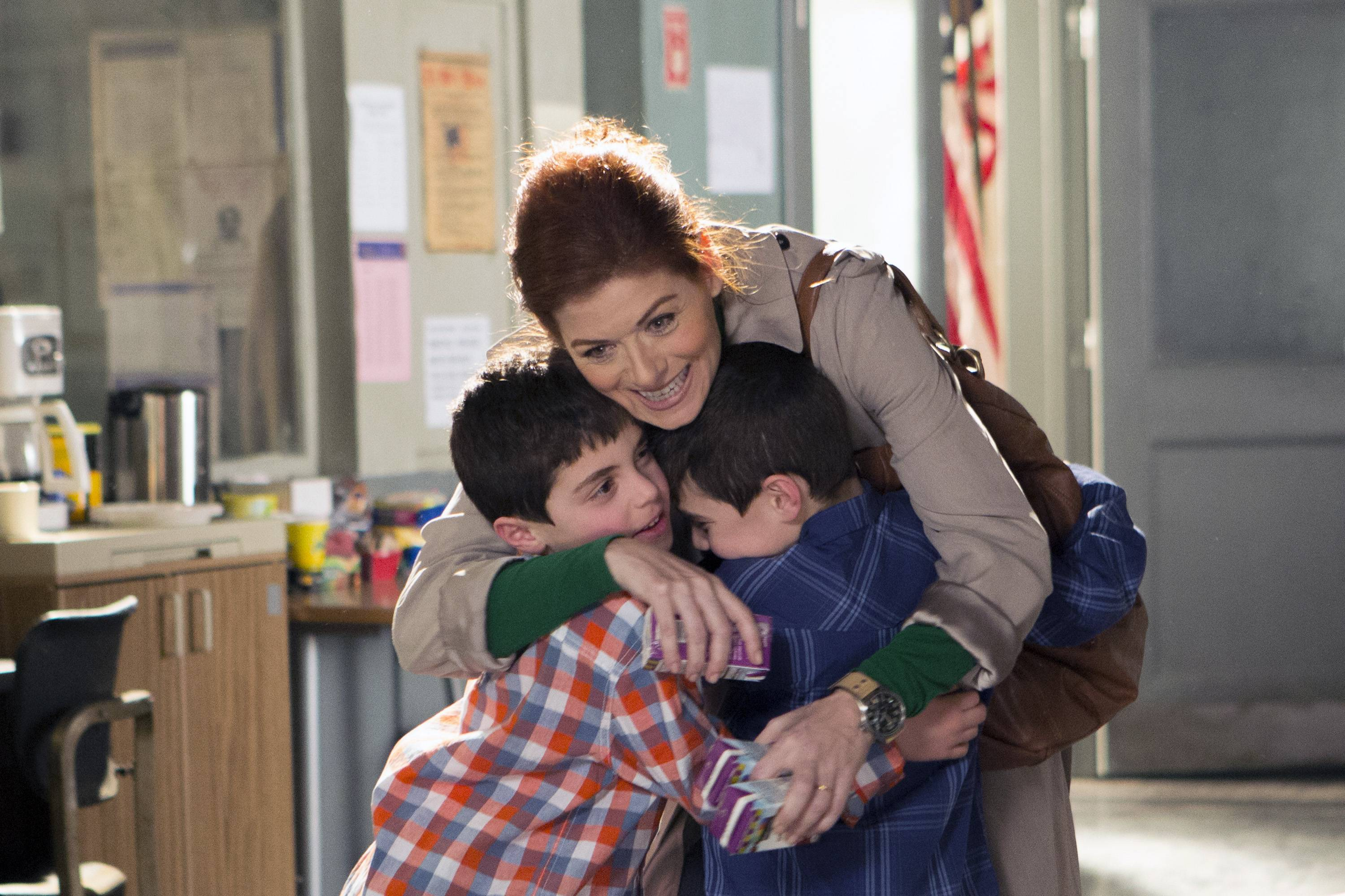 "Debra Messing, top, portrays Laura Diamond in the new NBC series ""The Mysteries of Laura."" Also in the series are Charlie Reina, left, as Harrison Diamond and Vincent Reina as Nicholas Diamond."