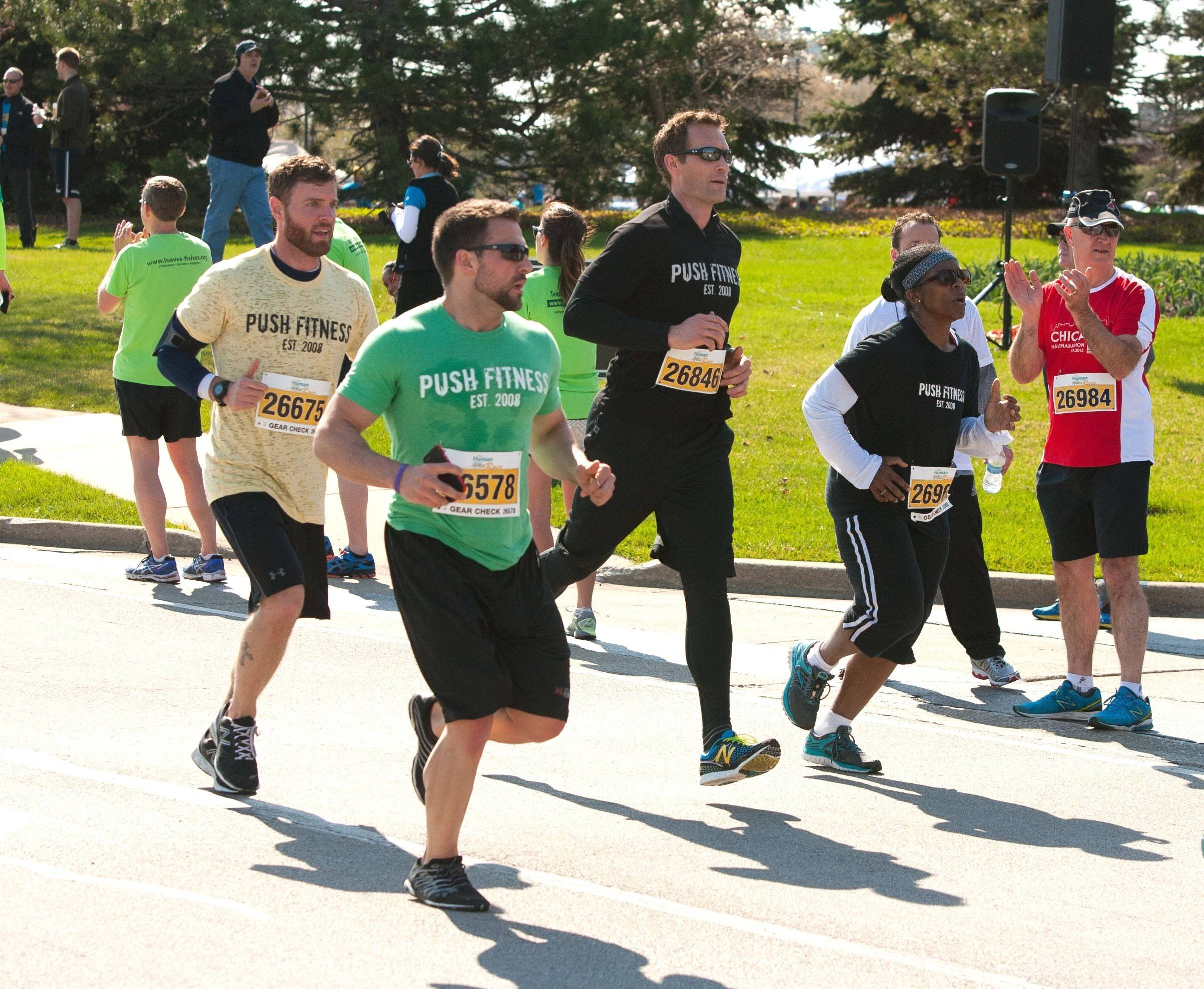 Personal trainer and Push Fitness owner Joshua Steckler (black T-shirt), has been alongside Lisa the whole way, including running at her pace and encouraging her throughout the DuPage Human Race 5K in Downers Grove April 26.
