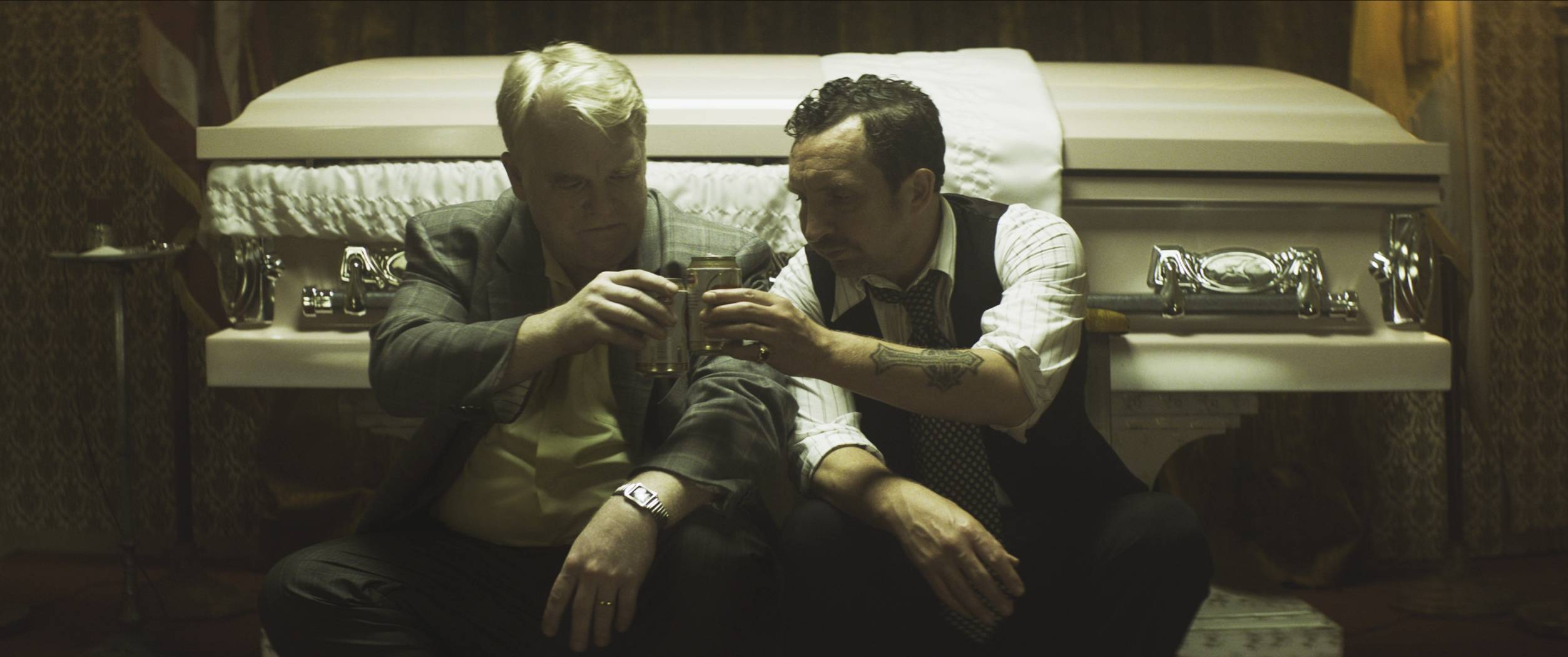 "Philip Seymour Hoffman, left, and Eddie Marsan star in ""God's Pocket,"" directed by John Slattery."