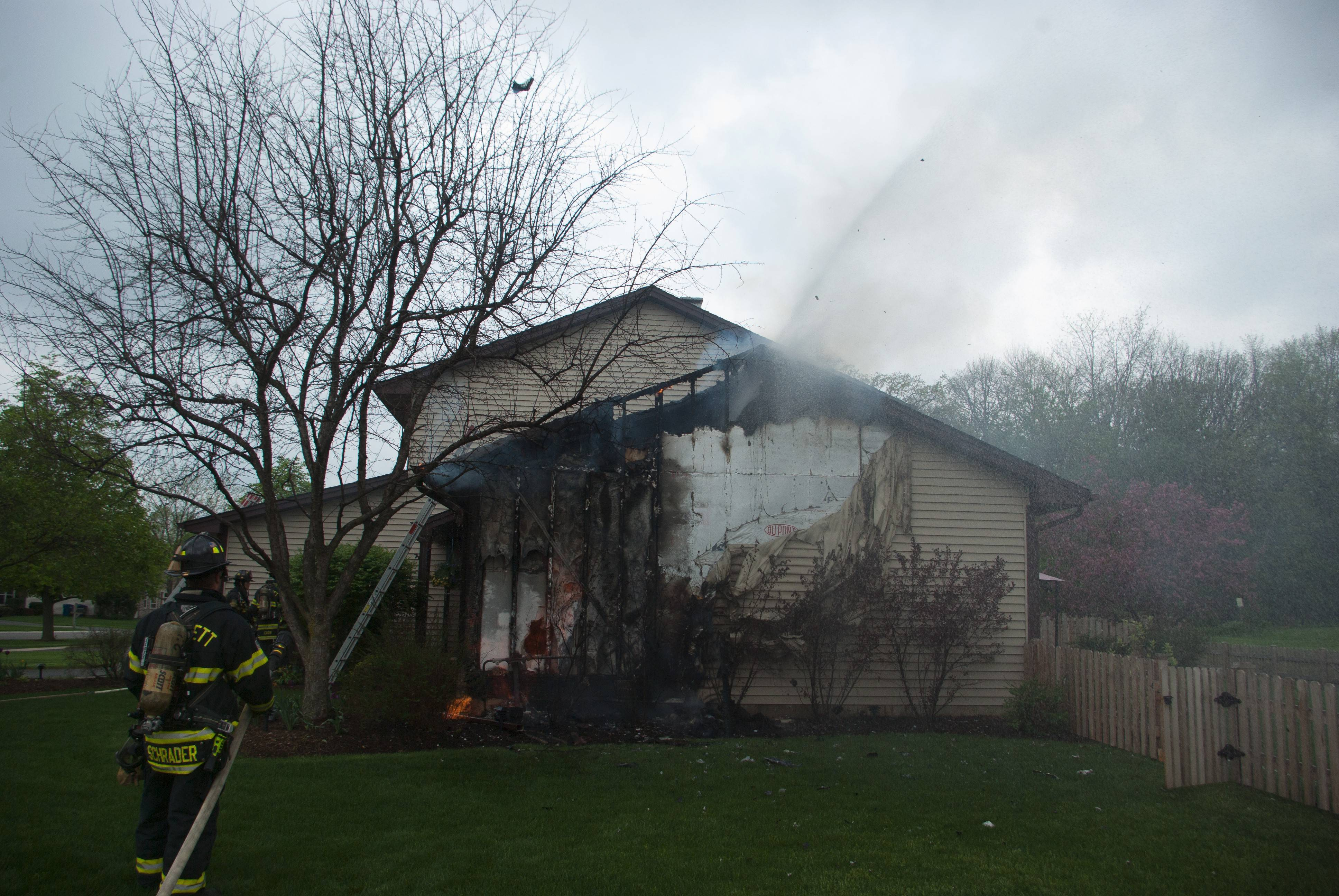 Barlett firefighters fight a blaze on Monday on the 700 block of Holly Drive.