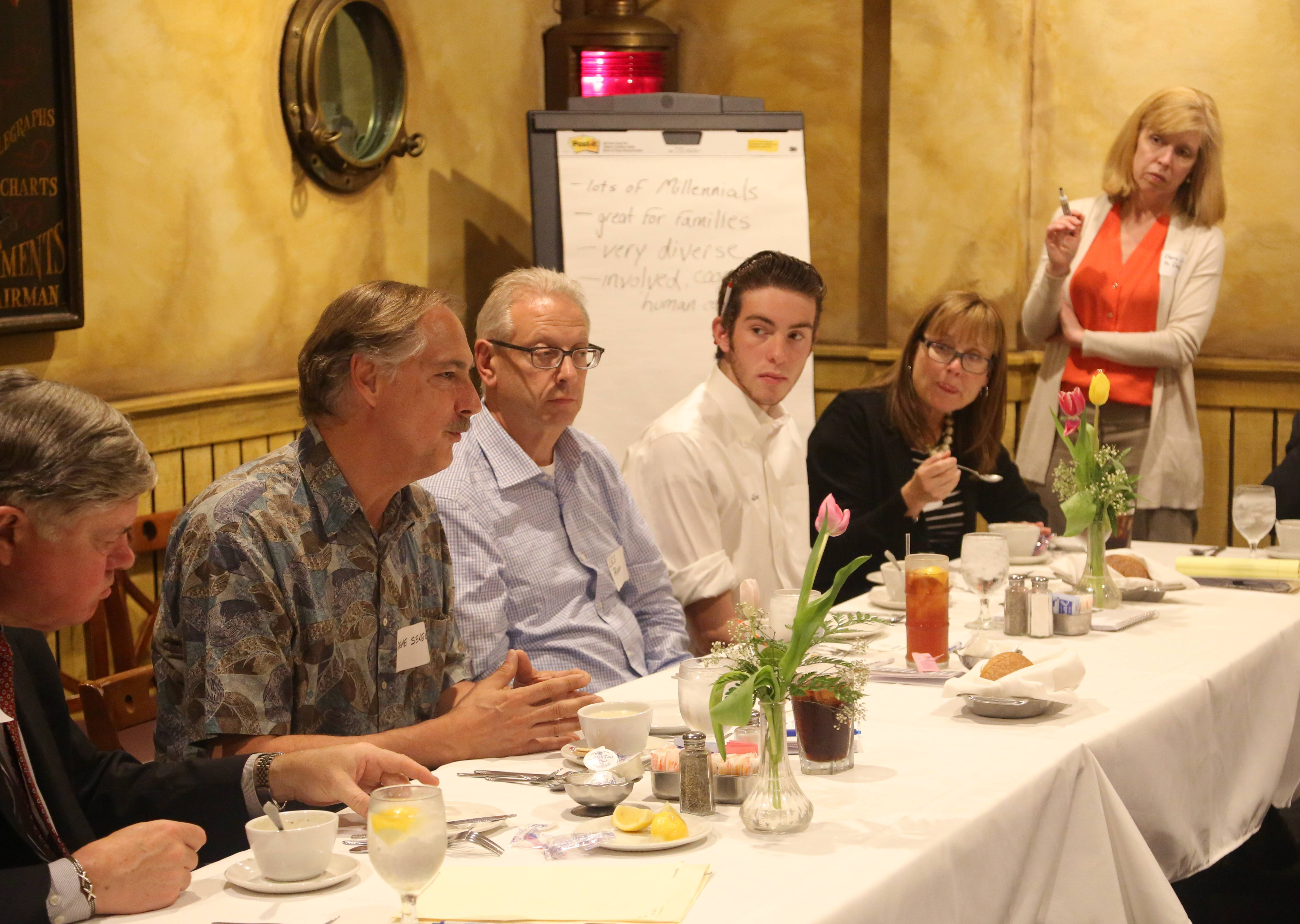 Lake County community leaders and residents participate in a round-table discussion Monday at Dover Straits in Mundelein.