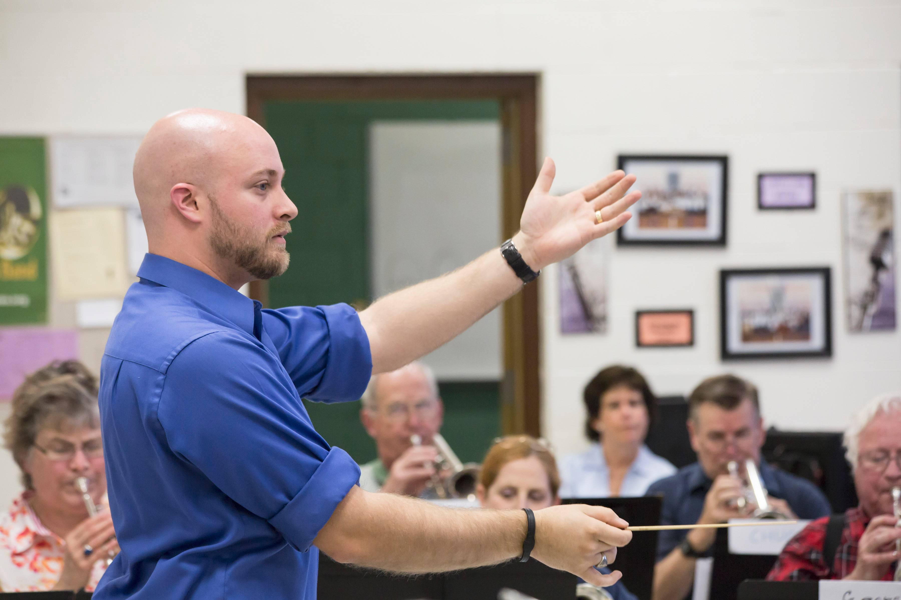 Peter Held, director of band, orchestra and choir at Christian Liberty Academy, works with the Prairie Brass Band as one of two finalists to be its new conductor.